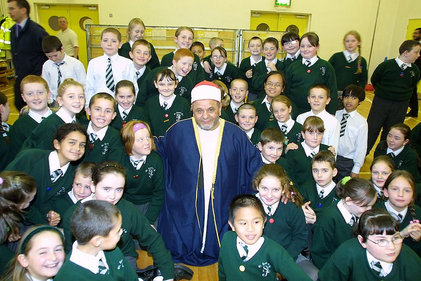 SALAAM ALAIKUM: Schoolchildren visiting with the Imam of the Belfast Islamic Centre