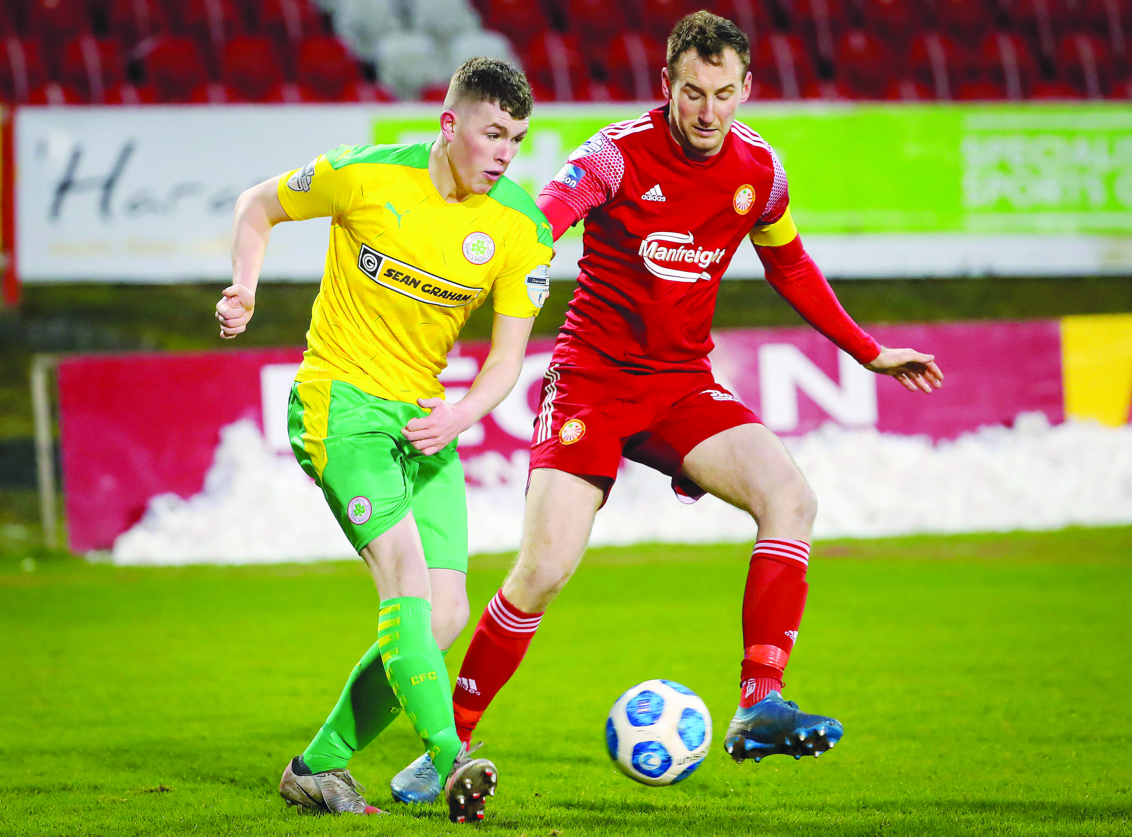 Portadown's Paul Finnegan closes in on Aaron Donnelly during a 1-1 draw between the teams back in February