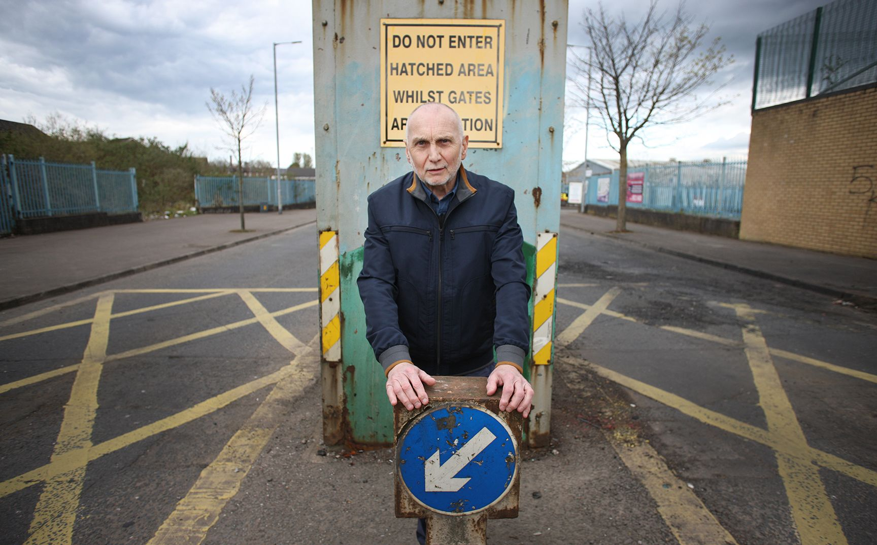 TAKING A STAND: Sean Murray at the Lanark Way gates that separates the Springfield Road from the Shankill Road