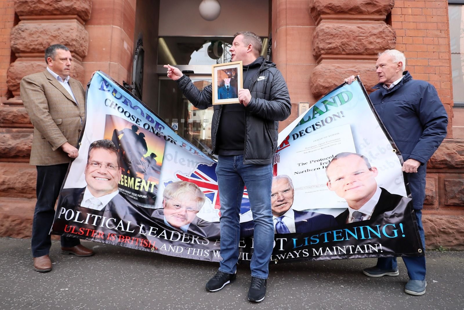 PROTESTING THE PROTESTERS: Gareth McCord, whose brother Raymond was shot dead by the UVF in 1997, disrupts a protest by David Campbell and David McNarry of the Loyalist Communities Council outside the offices of the Irish Secretariat yesterday.