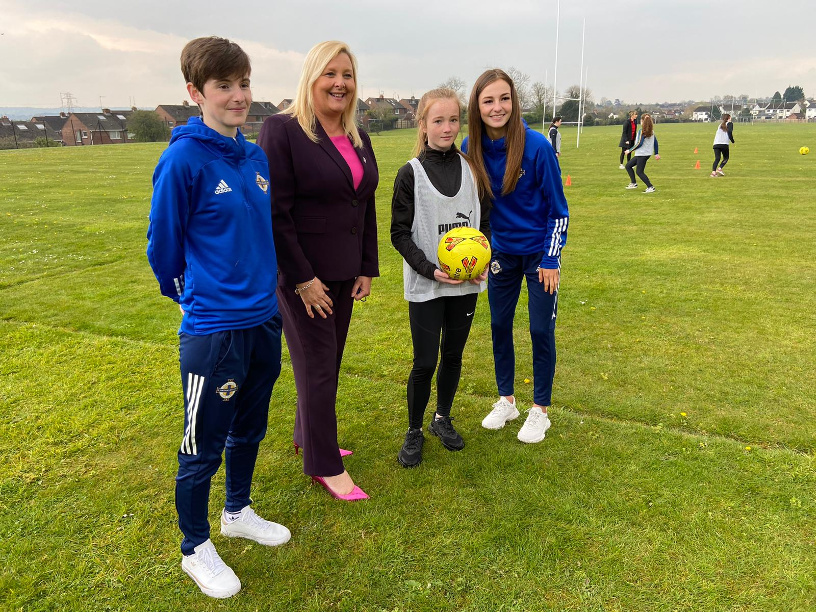 FAMILY AFFAIR: Kirsty and Caitlin McGuinness with their sister Orleigha and St Genevieve\'s Principal, Jackie Bartley
