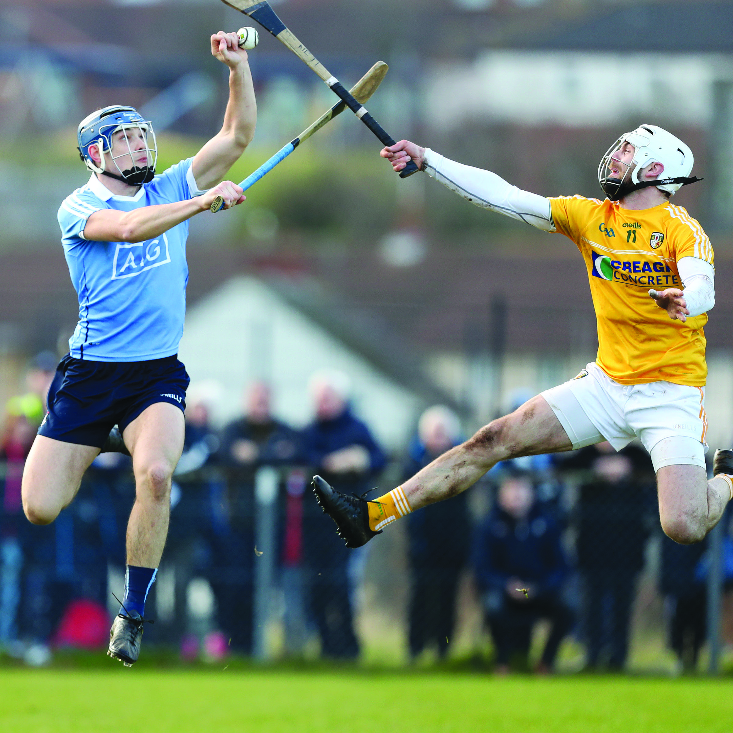Antrim's Neill McManus and Dublin's Eoghan O'Donnell (above left) fight for possession during the last competitive meeting between the sides at Corrigan Park in 2018 and they'll clash again in the quarter-final of the Leinster SHC later in the year.