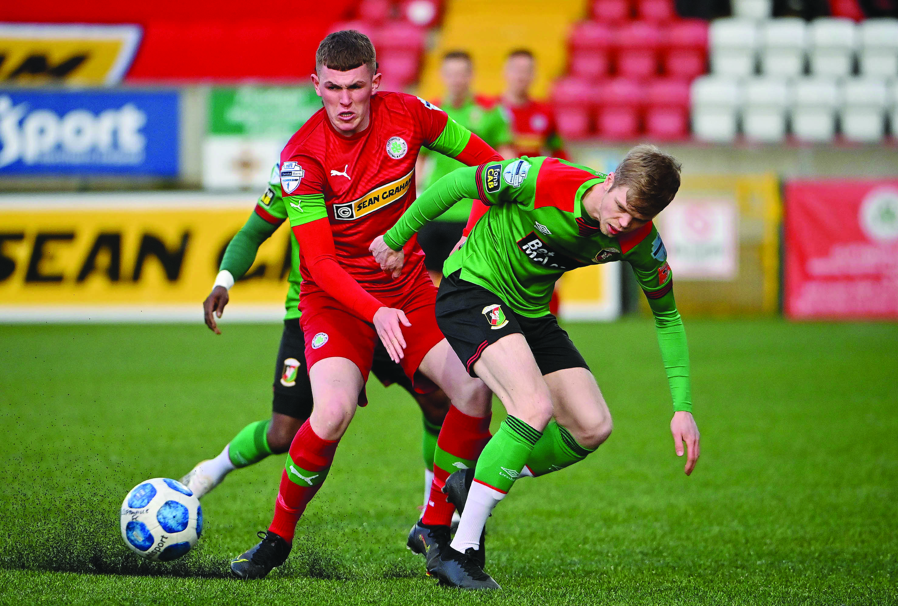 Cliftonville's Aaron Donnelly tries to hold off the challenge from Glentoran\'s Rhys Marshall during Tuesday night's 2-0 defeat at Solitude and the Reds will be hoping to bounce back when they host Carrick Rangers on this afternoon
