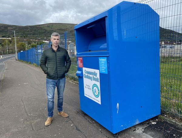 BAFFLED: Cllr Stevie Corr says clothes bins — such as this one on the Whiterock Rod — were installed without permission