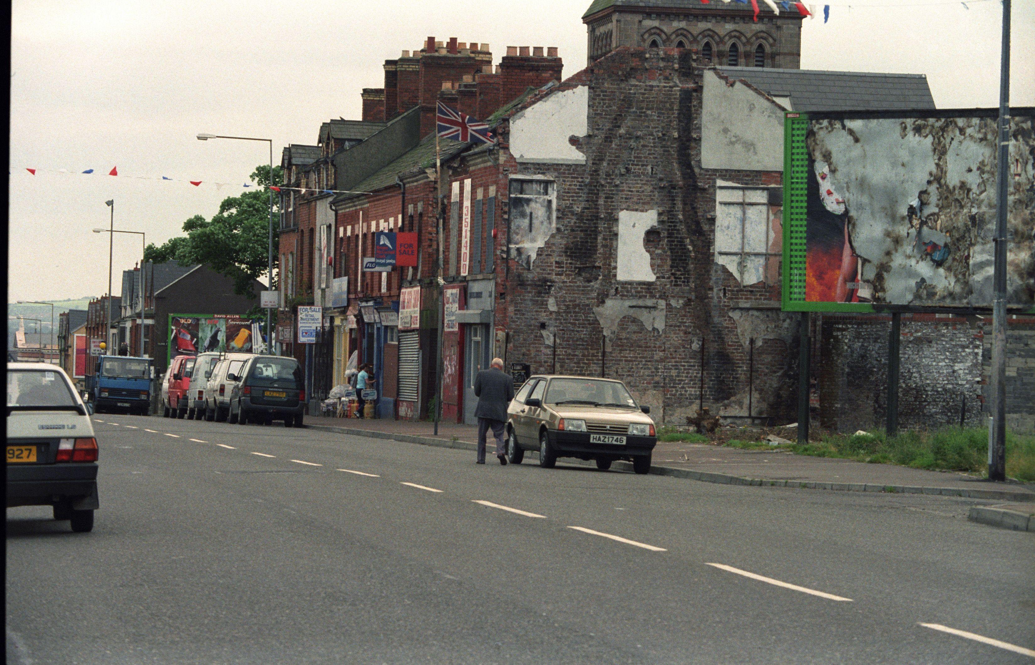 SO MUCH TO CELEBRATE: A depressed Crumlin Road, Belfast, 1997.