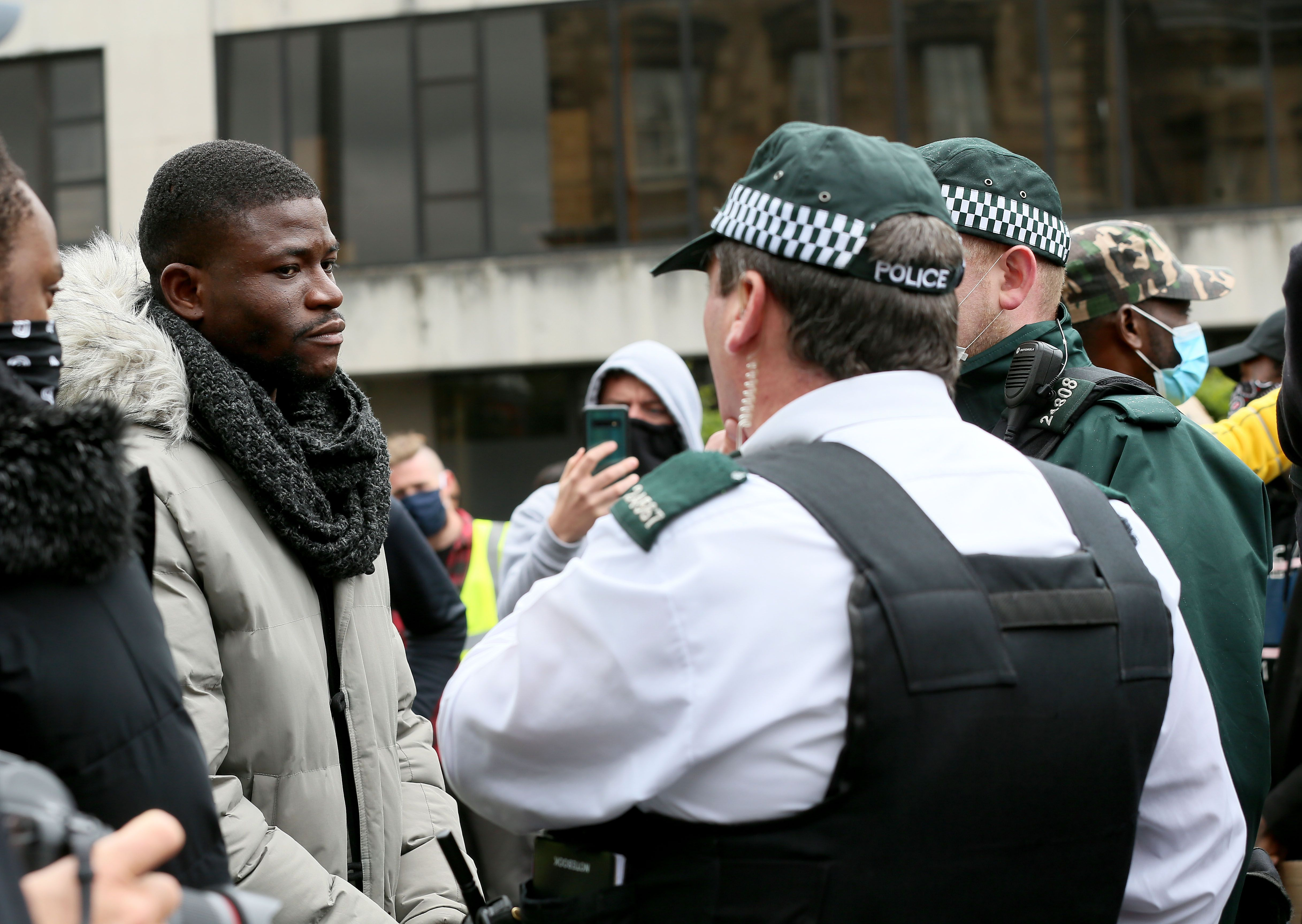 PROTEST: Black Lives Matter demonstrators being questioned by police at a George Floyd rally in Belfast in June 2020.