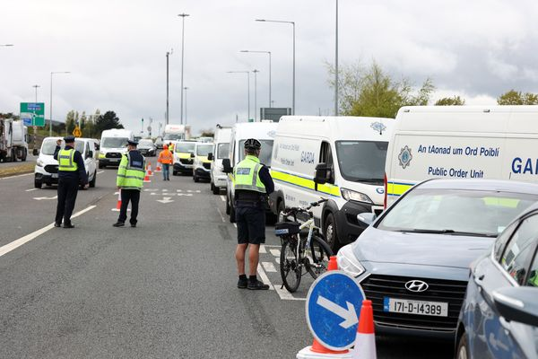 LOCKDOWN EASED: Covid restrictions have been loosened across the Republic of Ireland but Gardaí are pictured on Wednesday removing a marquee which had been erected outside Dublin for a wedding.