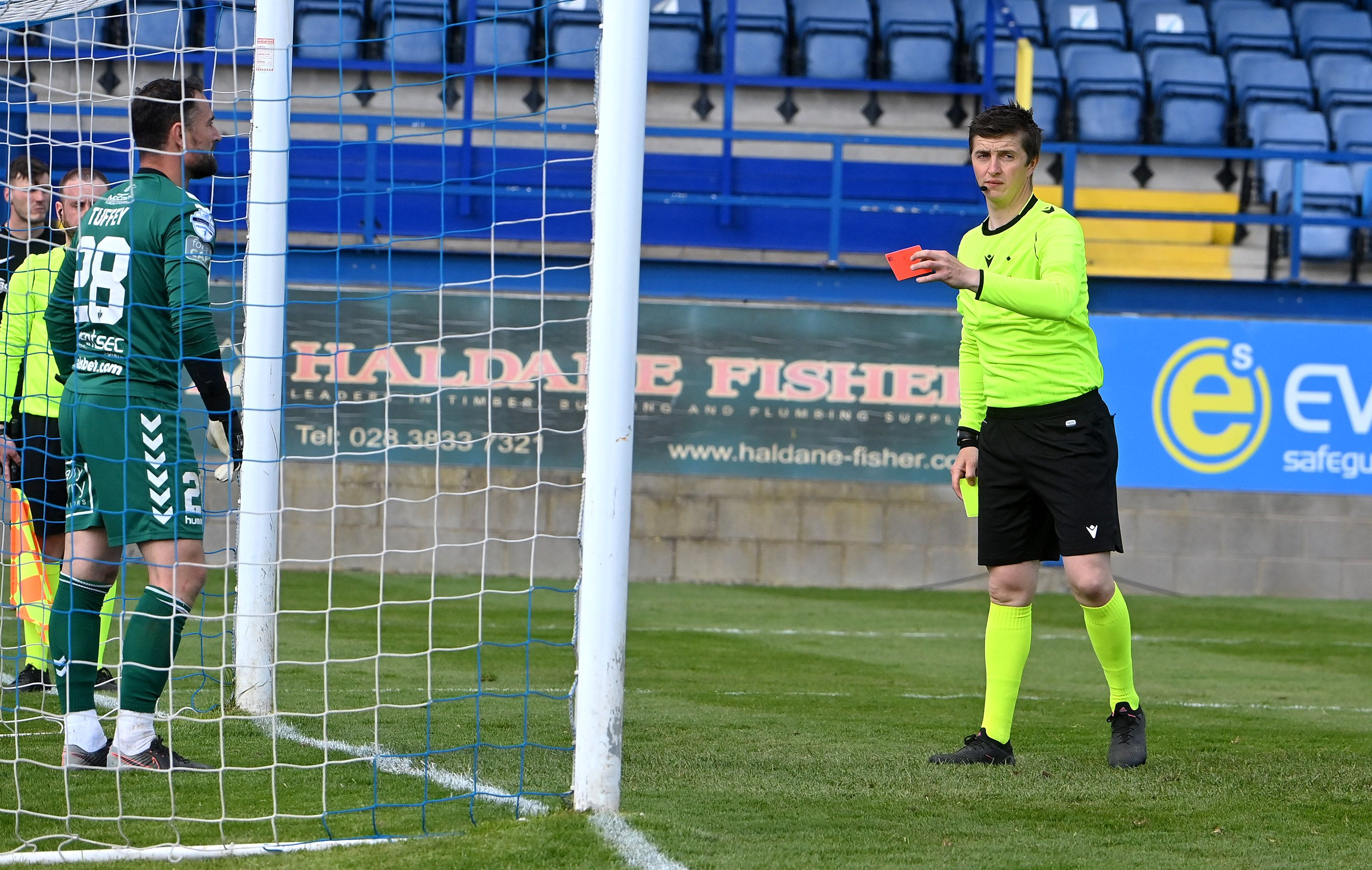 Crusaders goalkeeper Jonny Tuffey is shown a red card during the penalty shootout after stepping off his line for the third time
