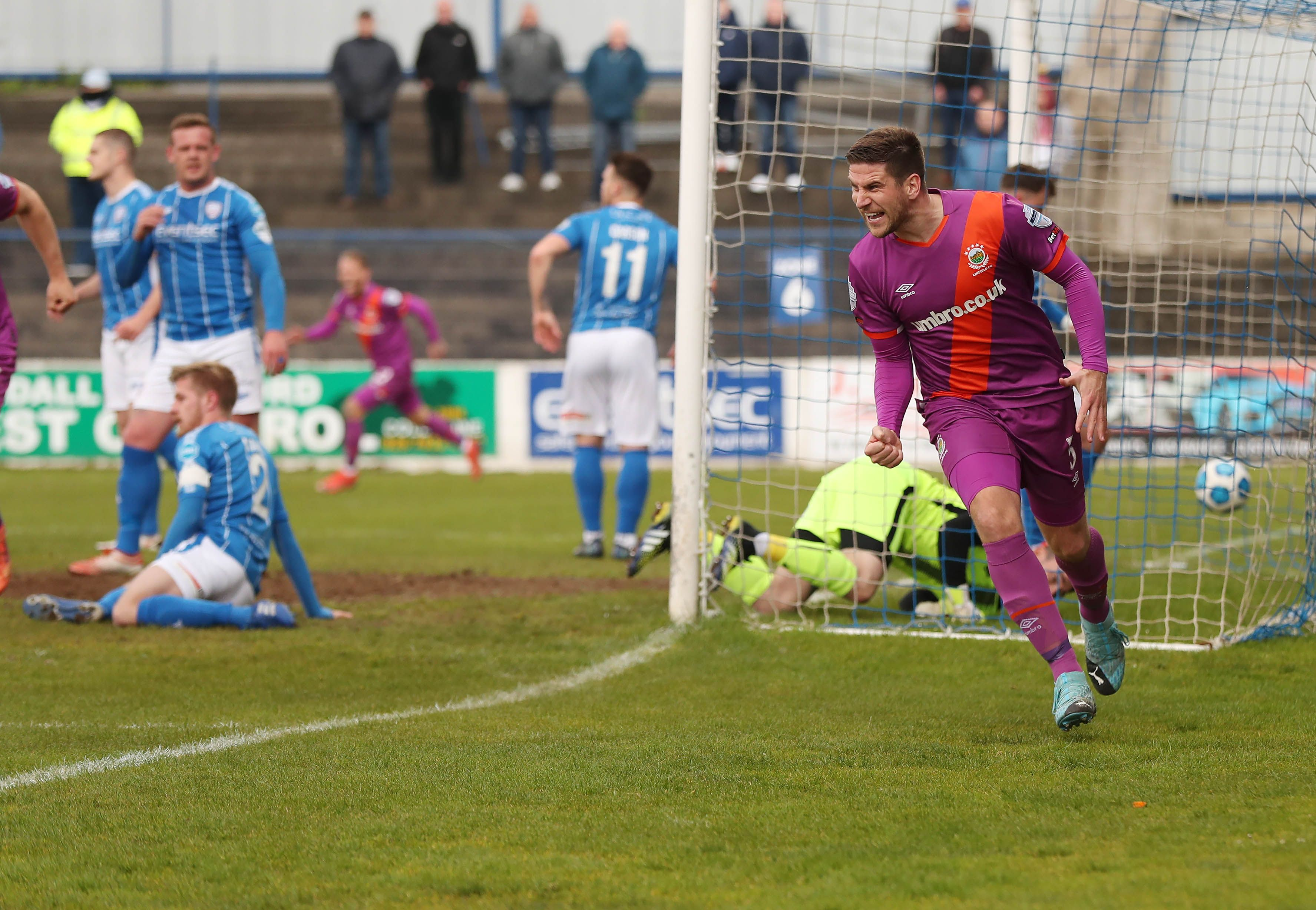 Mark Haughey wheels away after putting Linfield ahead at Coleraine