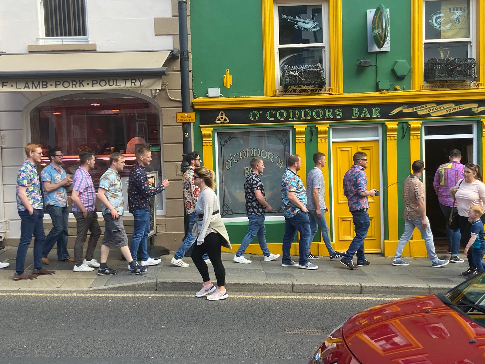 REOPENING PACE TO BE REVIEWED: Revellers queue to get into a bar in Ballycastle at the weekend.