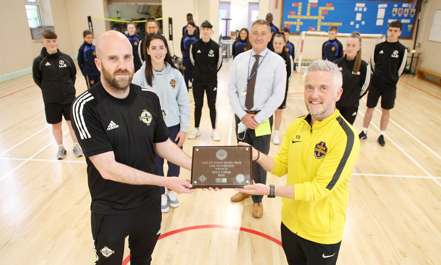 CONGRATS: Damien McLaughlin from the Irish FA presents Séadna Billings, Head Coach of Football at Mercy College with the award