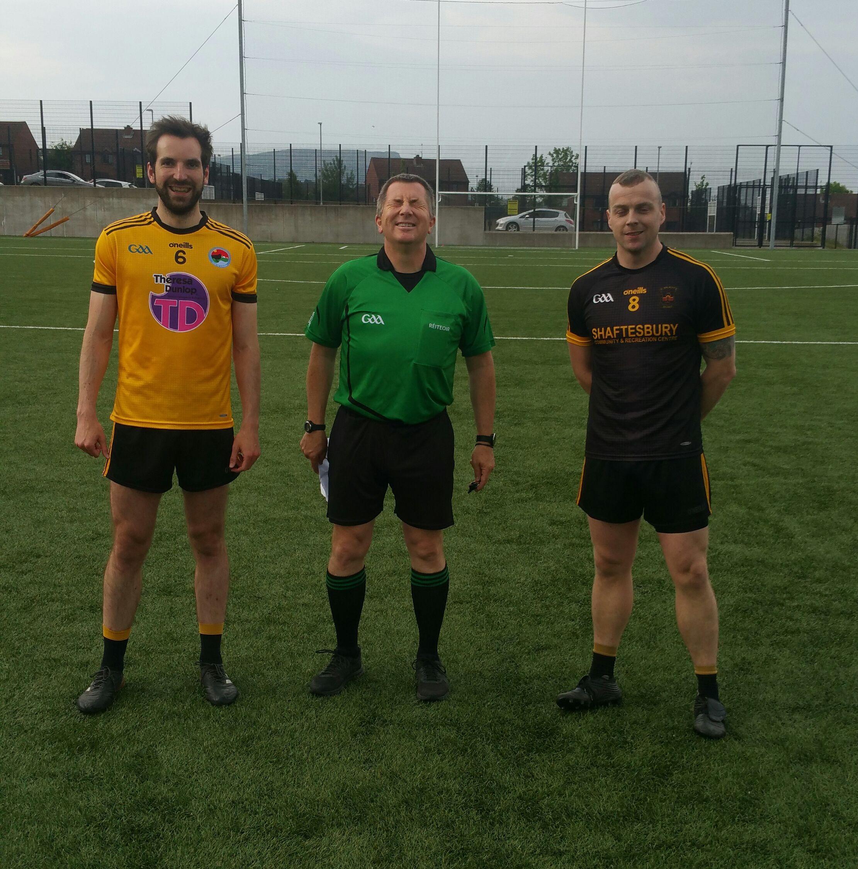 Team captains Connla Ó Coinn and Anthony Dobbin with referee Ray Matthews