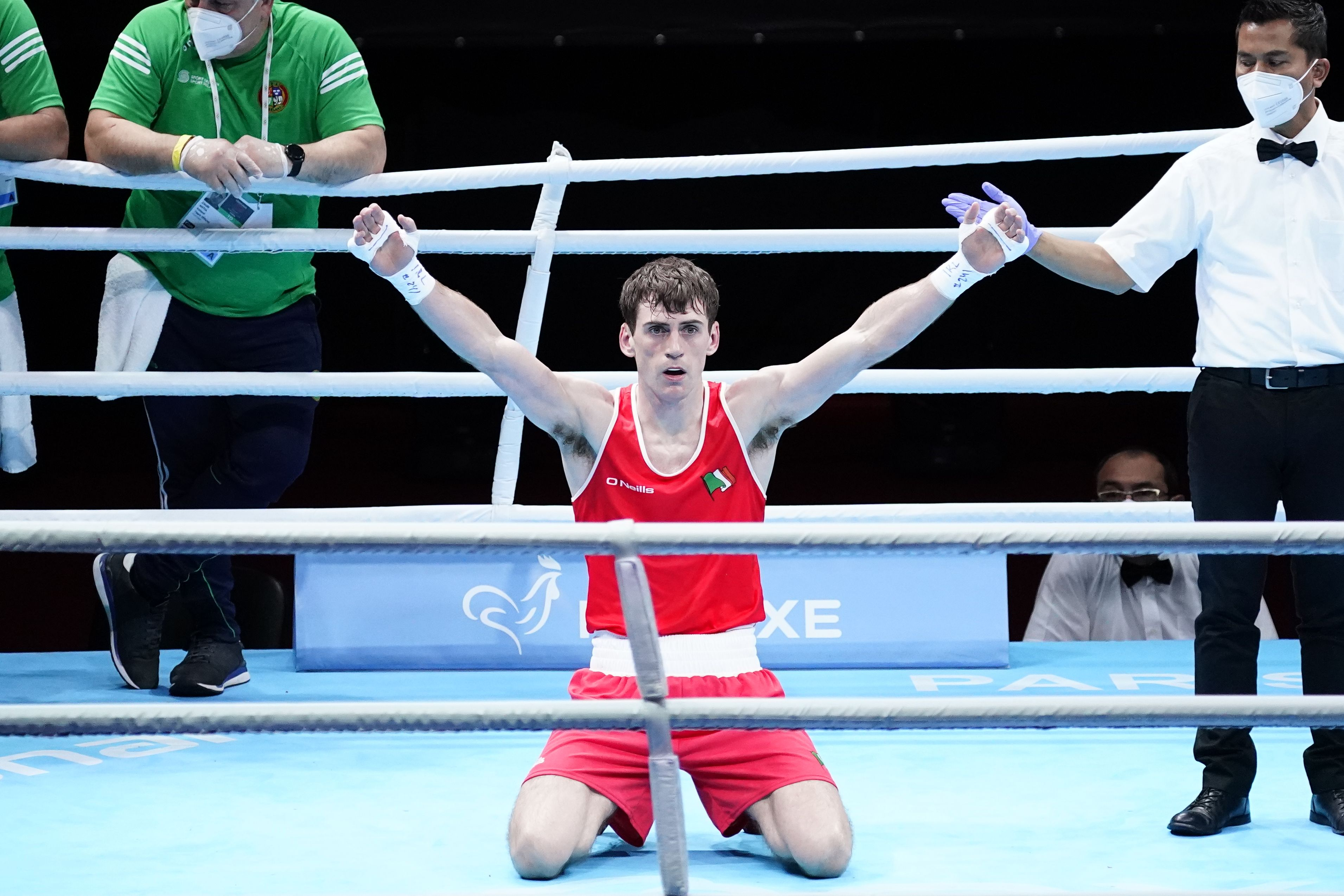 Aidan Walsh drops to his knees after victory over Yevheni Barabandy