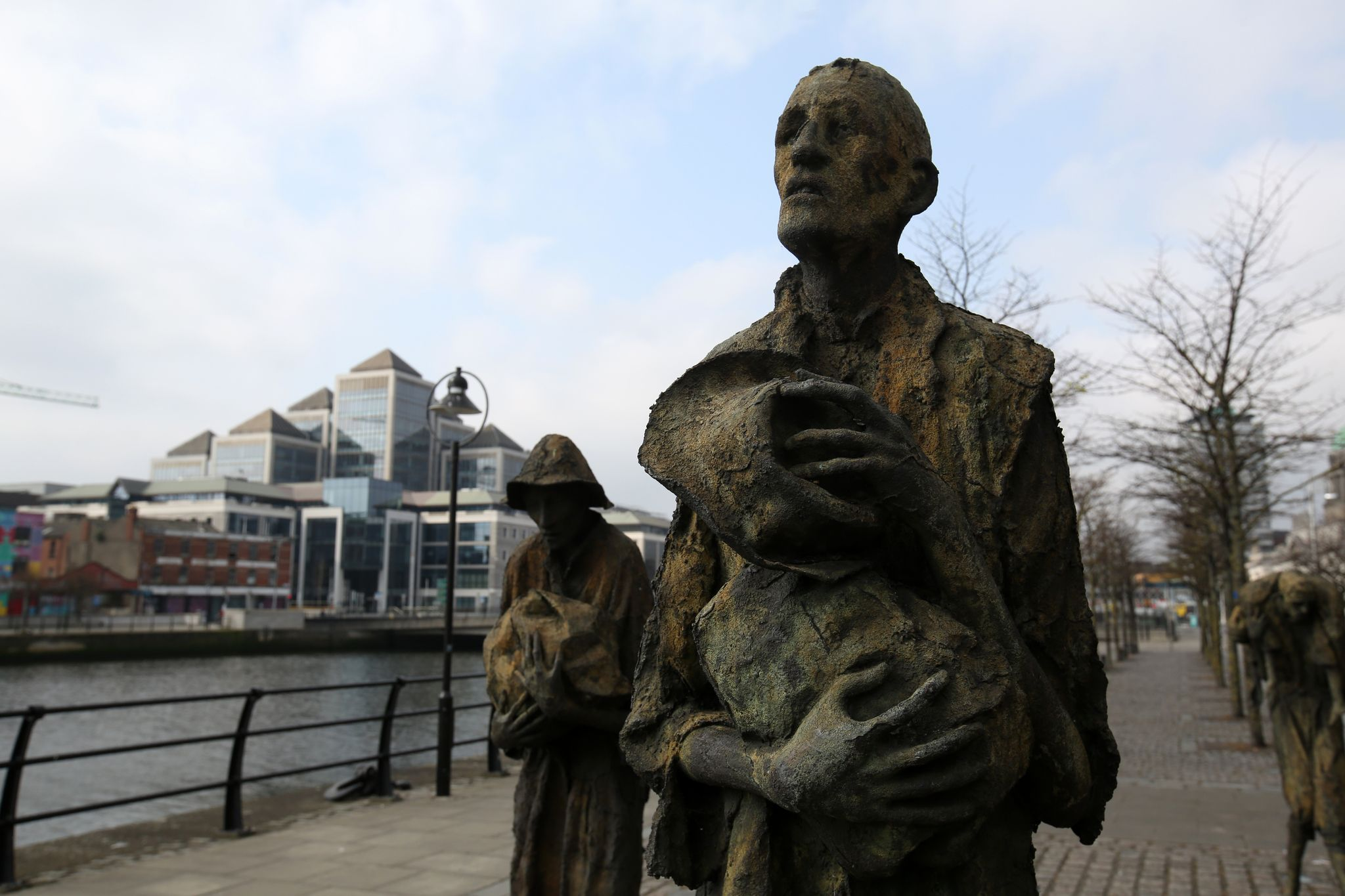 HEROES OF THE HORROR: Great Hunger victims await the coffins ships to America as depicted by sculptor Rowan Gillespie at Dublin port.