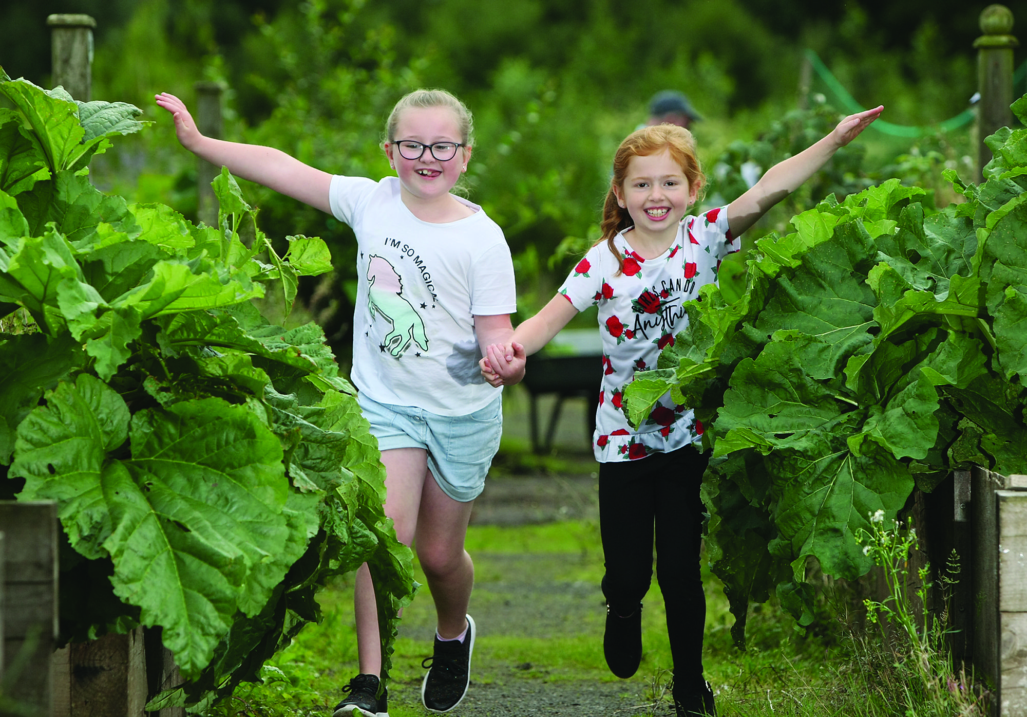 JOY: Cousins Phoebe Devlin and Evie Sewell enjoying the Colin Neighbourhood Partnership annual allotment festival back in 2018.