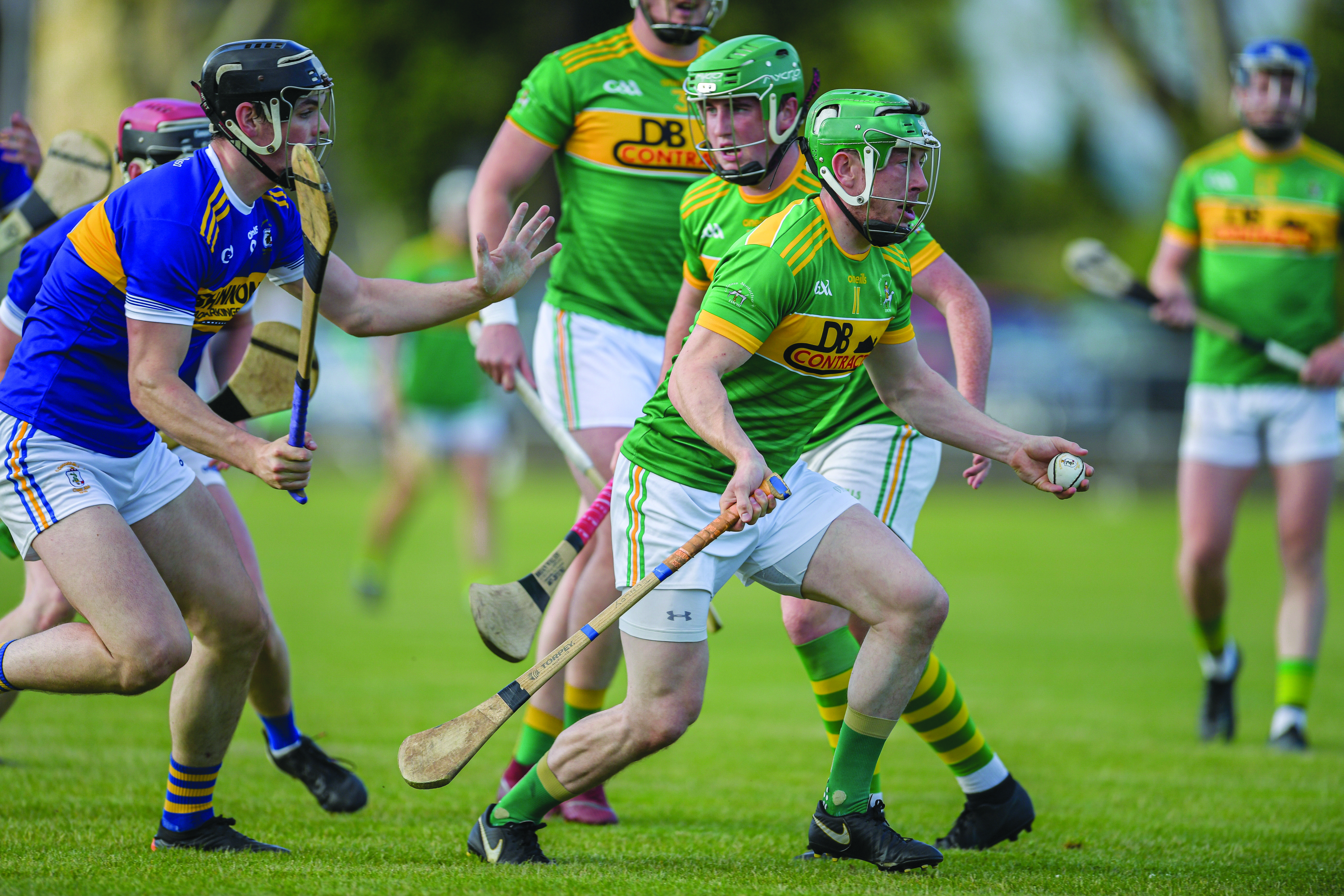 Dunloy\'s Kevin Molloy tries to break away from Rossa\'s Gerard Walsh during Wednesday night\'s Division One clash at Pearse Park