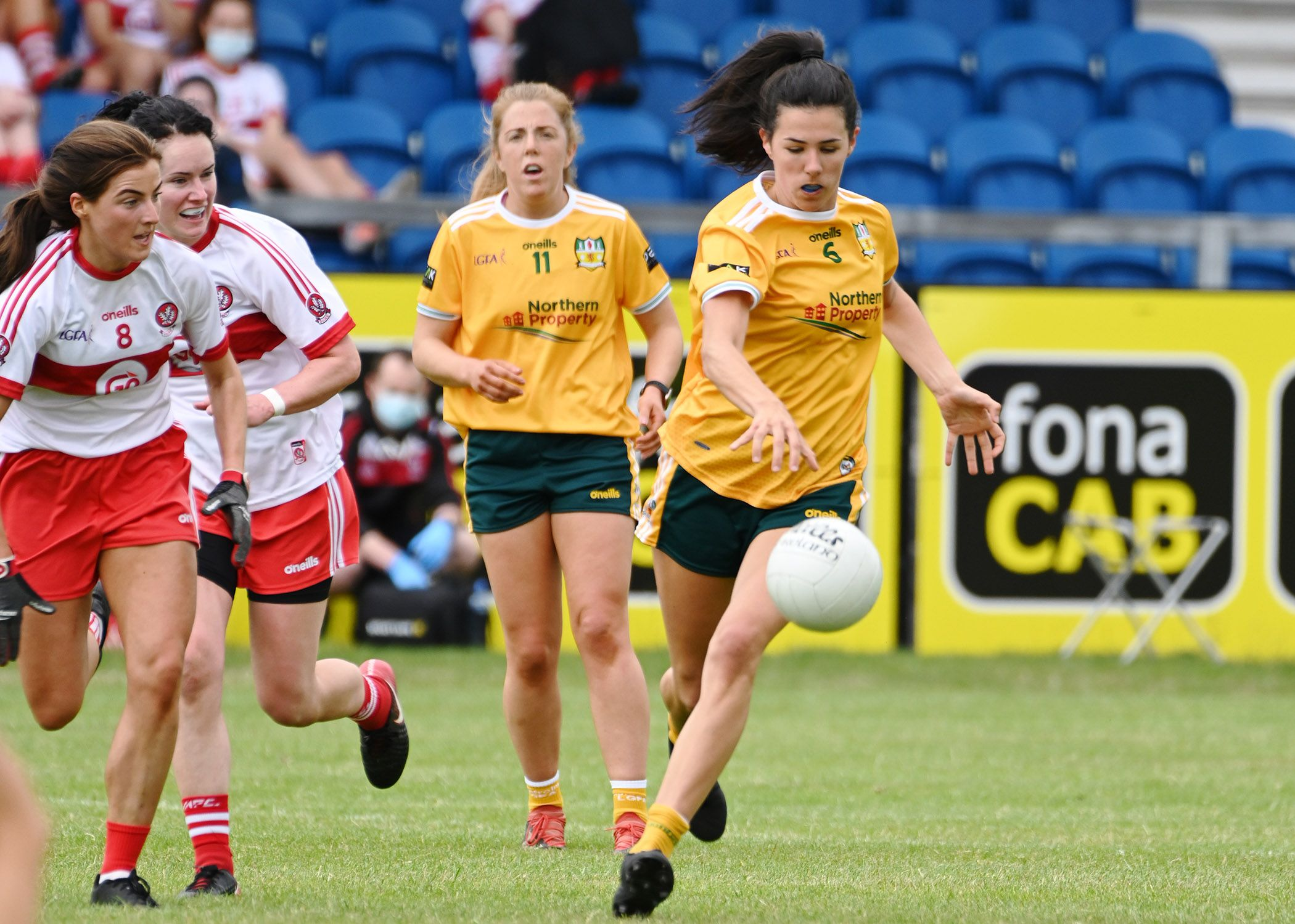 Antrim's Maeve Blaney tries to break free of the Derry challengers, led by midfielder Aine McAllister during Sunday's game at Corrigan Park