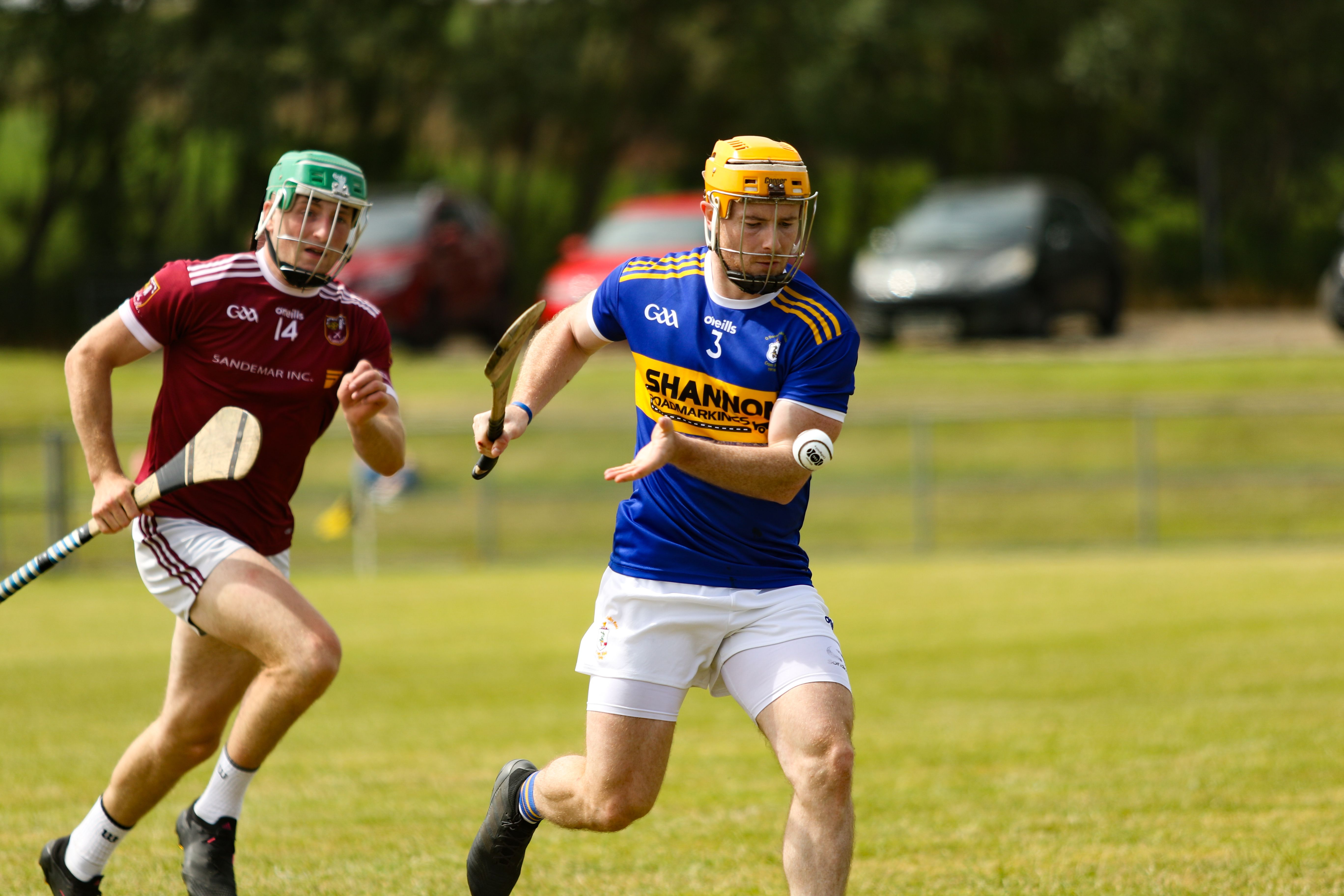Ciaran Orchin clears under pressure from Niall McCormick