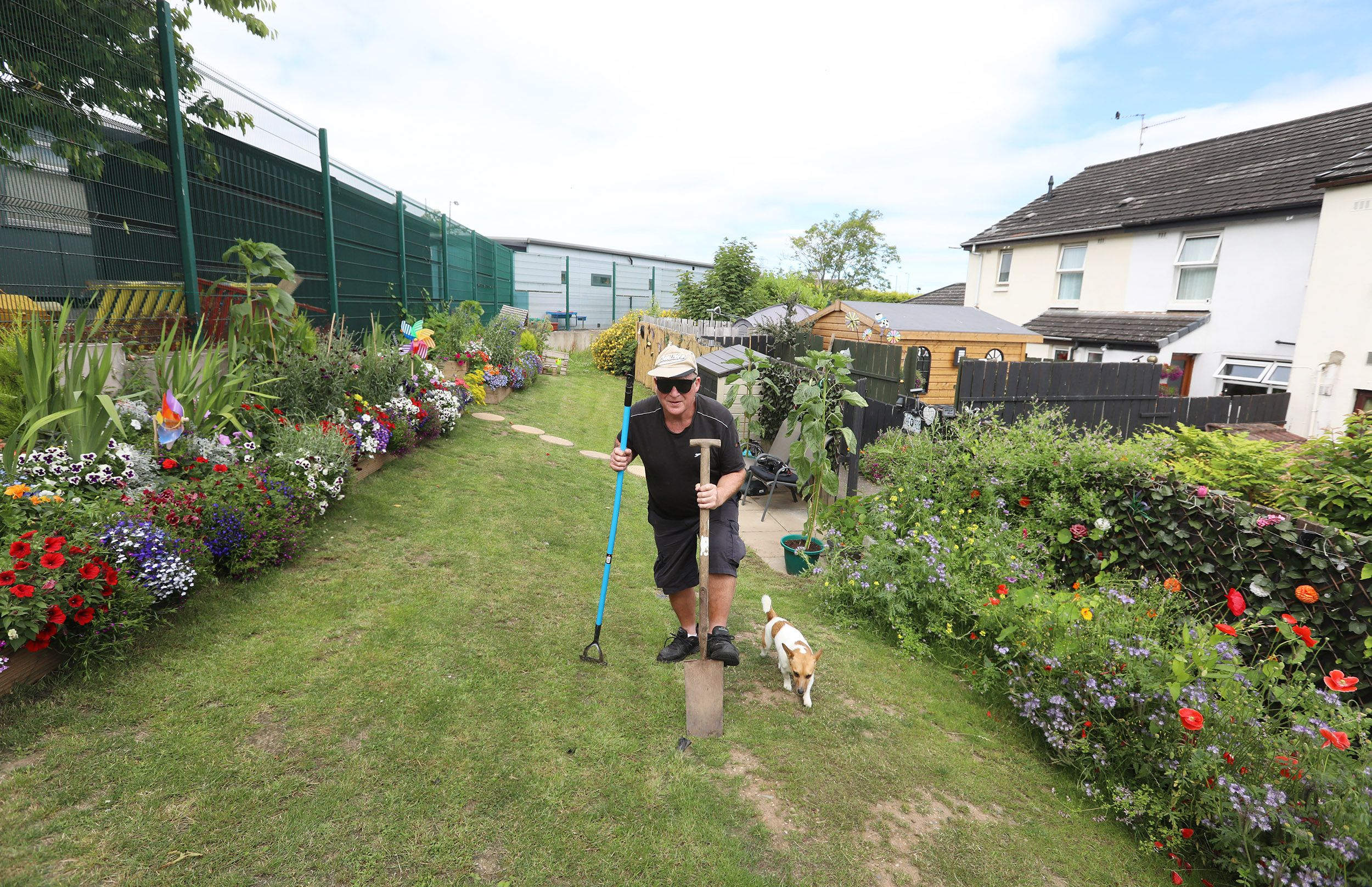PARADISE: Terry Johnson and his dog Keano enjoy the colourful garden
