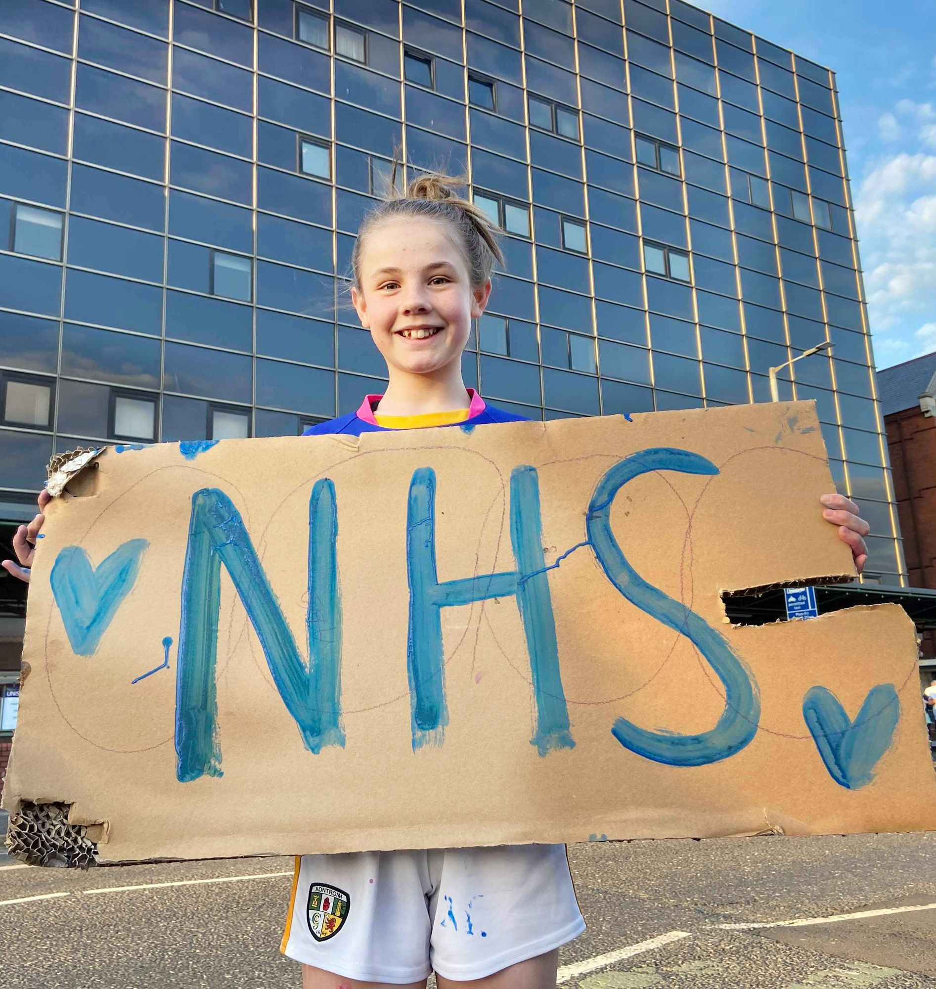 SOLIDARITY: Nine hospitals are over-capacity as Covid numbers surge again. Pictured in May of last year demonstrating support for HSC staff outside Mater Hospital is Jessica Massingham.