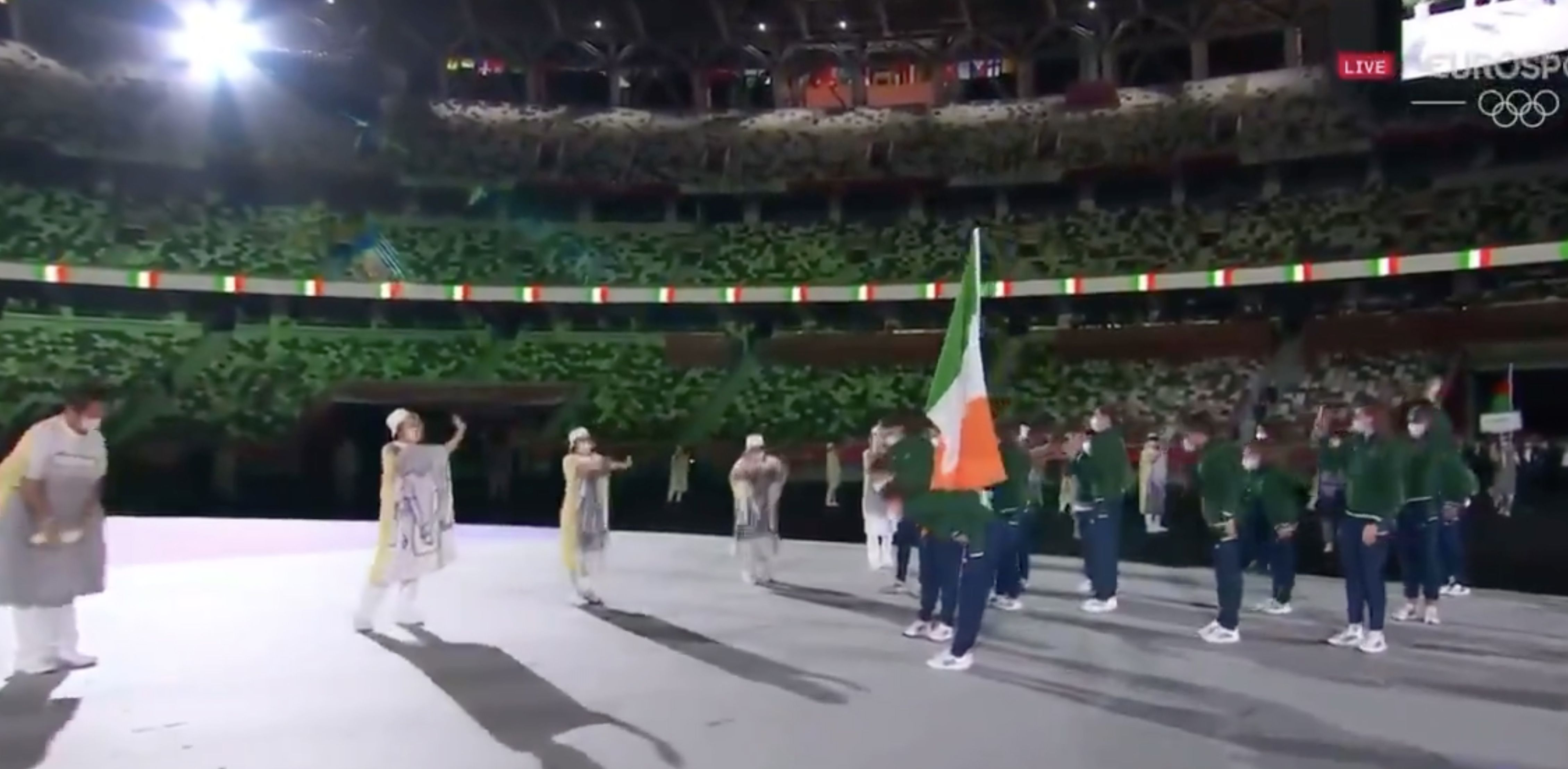 RESPECT:Kellie Harrington, Brendan Irvine and colleagues bow to their hosts at the Olympic parade of nations on the opening day
