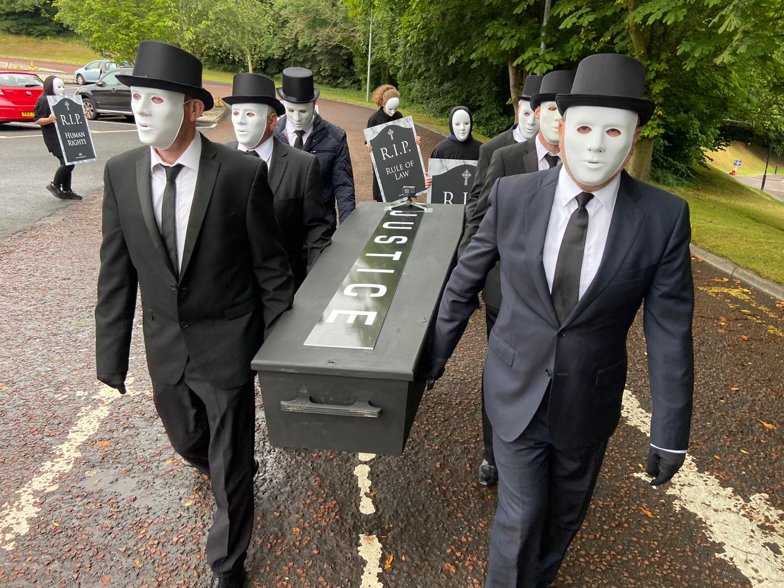 """SOLEMN: Victims\' families carry the coffin of \""""justice\"""" to the Northern Ireland Office at Stormont"""