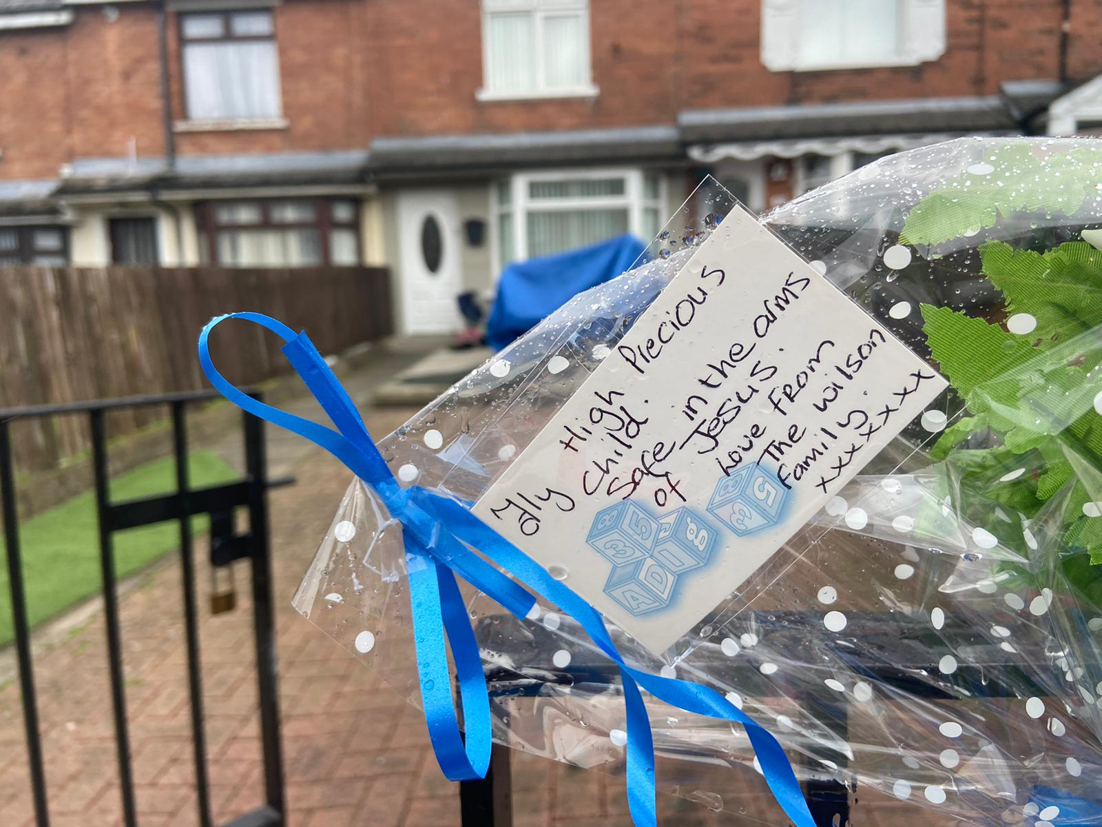 COMMUNITY SUPPORT: Tributes including flowers and teddy bears have been left at the house in Brompton Park in Ardoyne