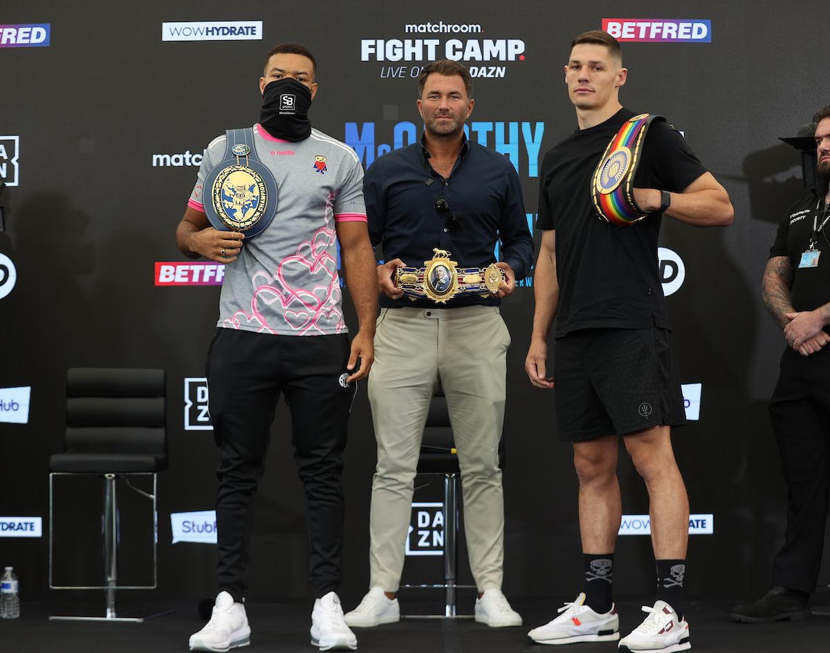 Tommy McCarthy and Chris Billam-Smith with promoter Eddie Hearn and the three belts up for grabs tomorrow night