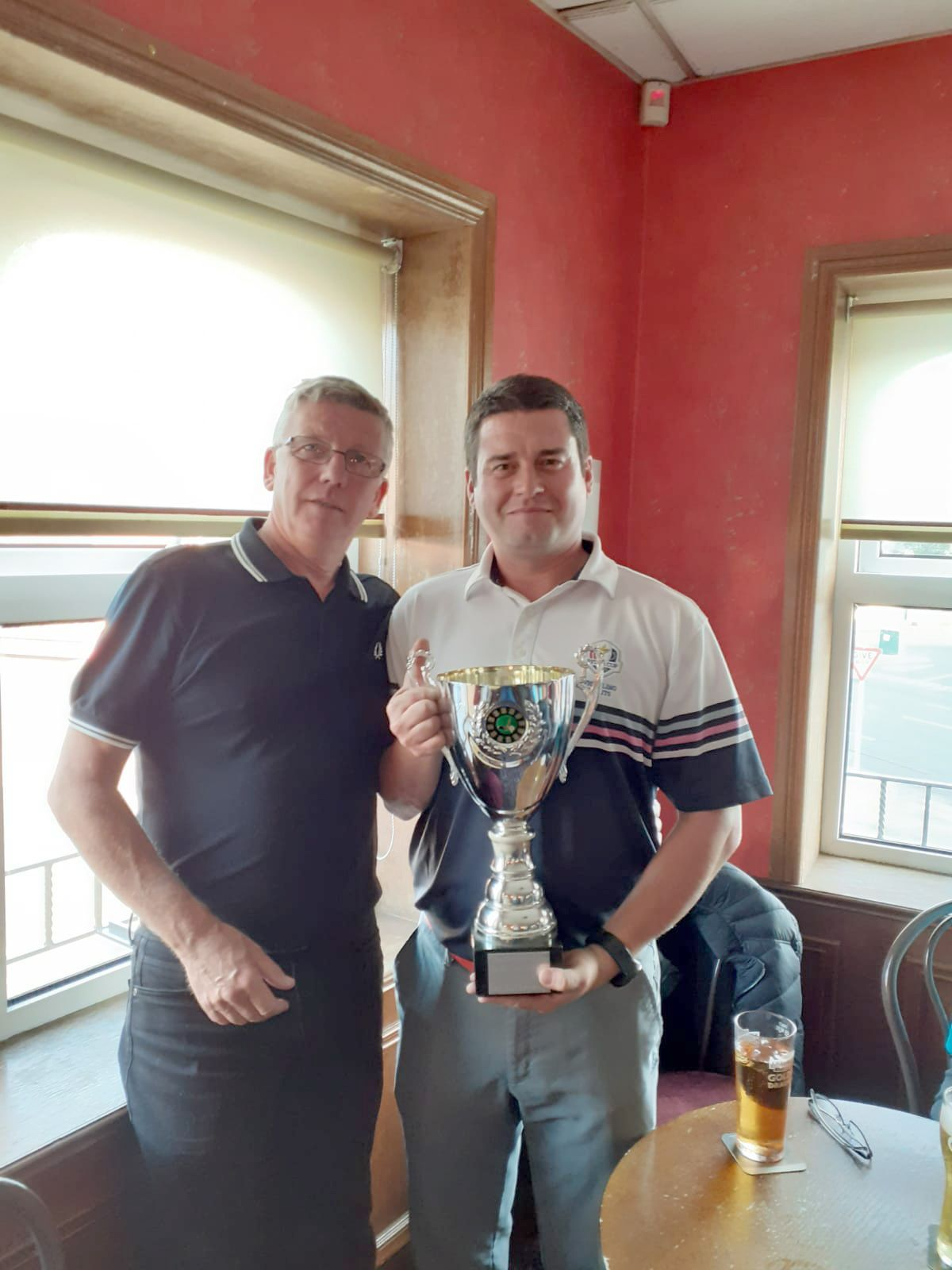 WELL DONE: Daryl and Paul Conn from the Dirty Dozen hold the Challenge Cup (BELOW) HEAD TO HEAD:Golfers from the Glen Inn and Bellevue Arms before their annual match