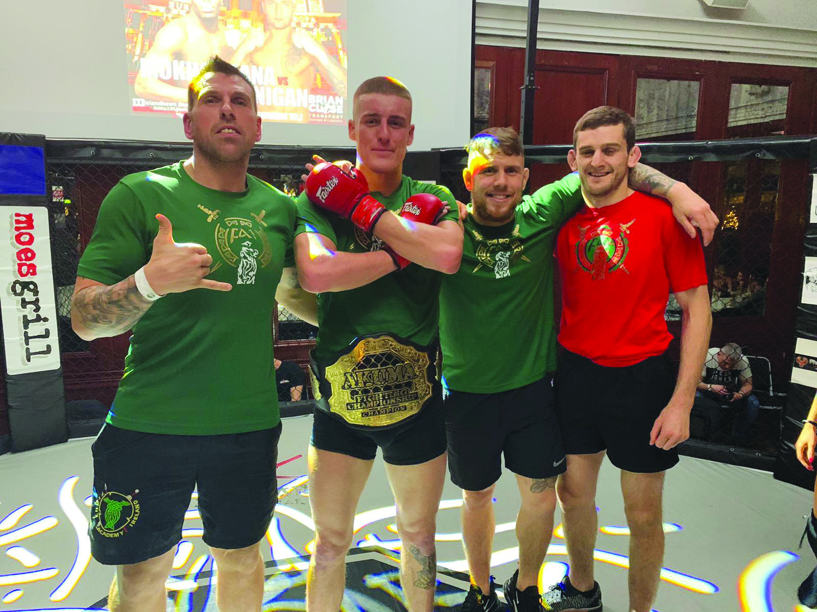Fight Academy head coach Liam Shannon with Paddy McCorry, coach Patrick McAlister and Cage Warriors world lightweight champion Joe McColgan