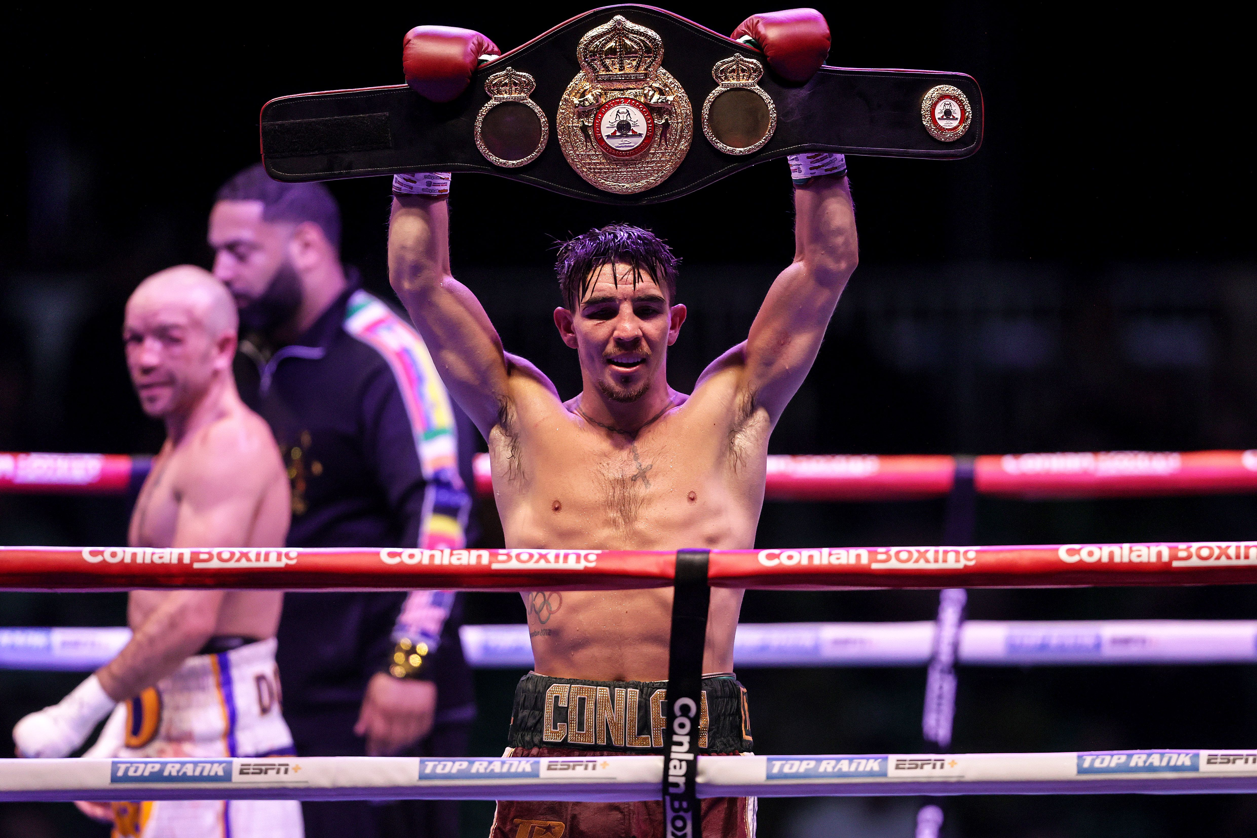 Michael Conlan holds aloft the interim WBA featherweight belt after his unanimous points victory against TJ Doheny