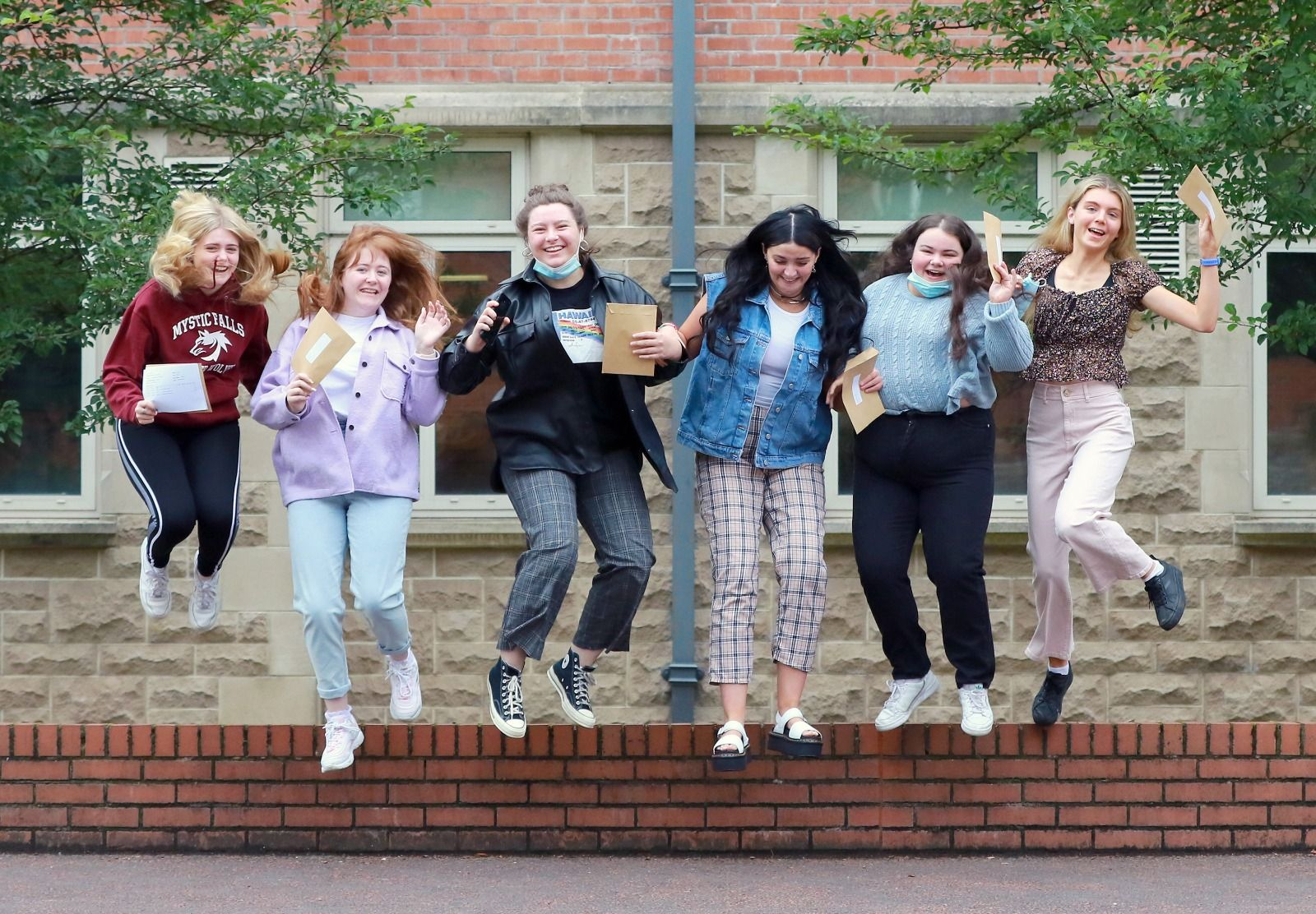 HEROES: Pupils at St Dominic\'s celebrating their A-level results today
