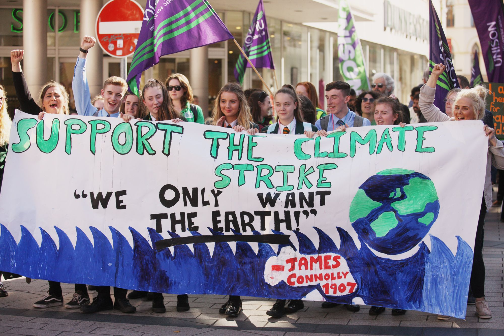 LEADERSHIP FROM YOUTH: Local school pupils leading the global climate change strike march to the city centre in 2019.