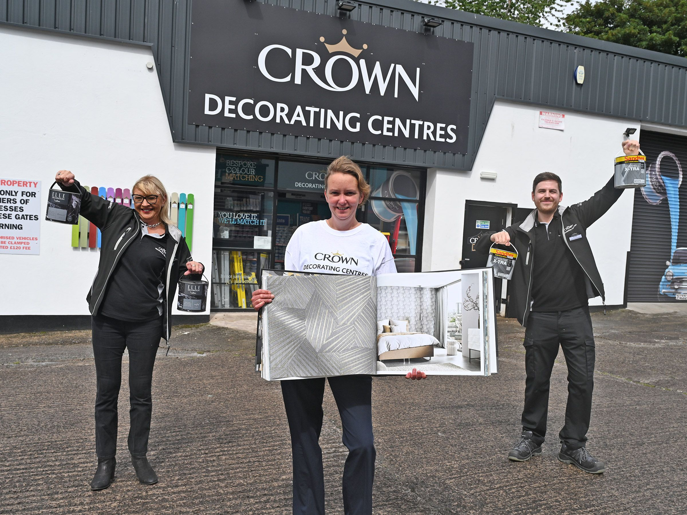 NEW STORE: Cathy McQuaid (Branch Manager), Valerie Parke (Regional Operations Manager) and Dave Marron