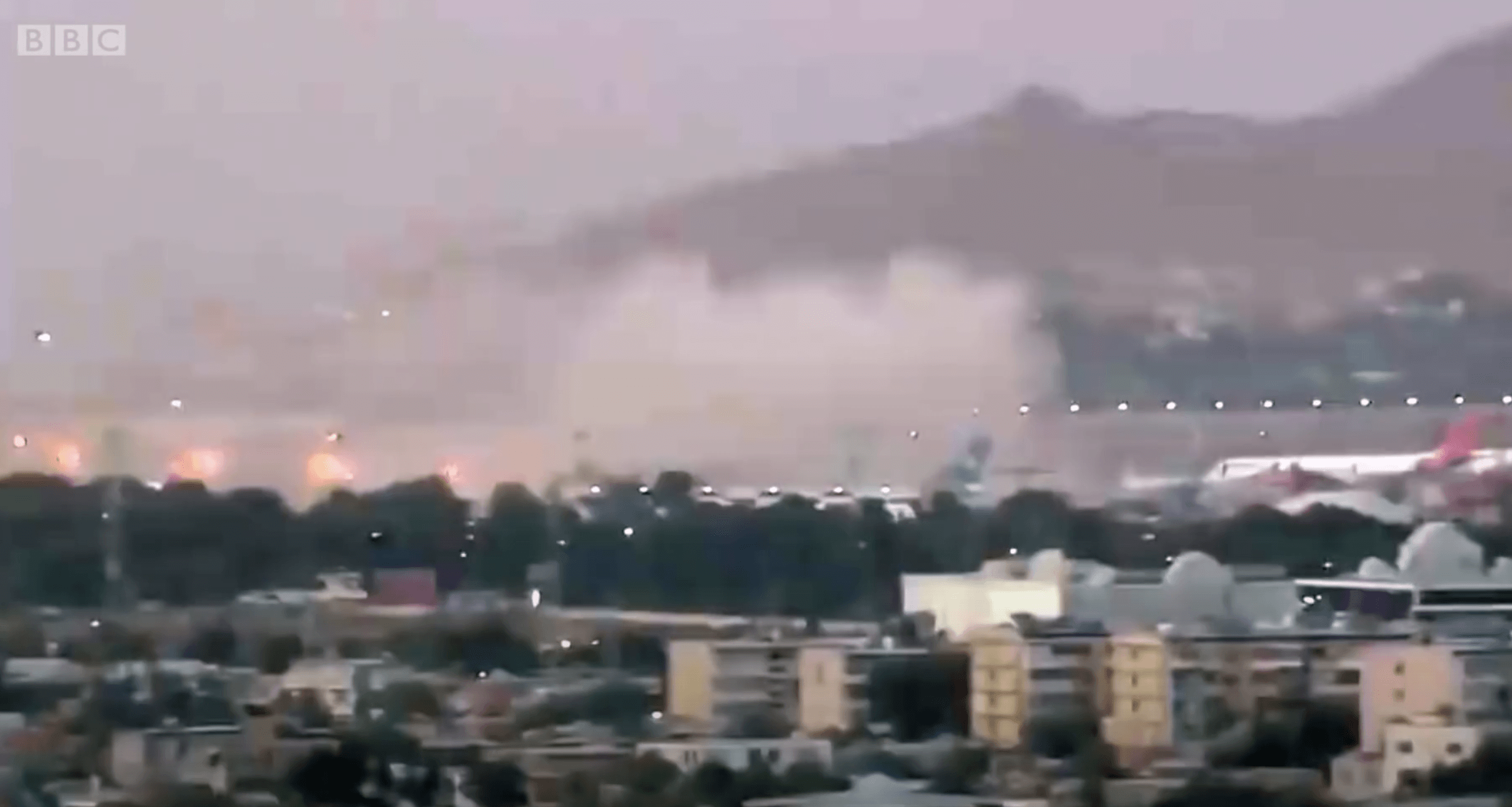 OUTRAGE: Plumes of smoke rise up from outside Kabul Airport after Thursday\'s attack