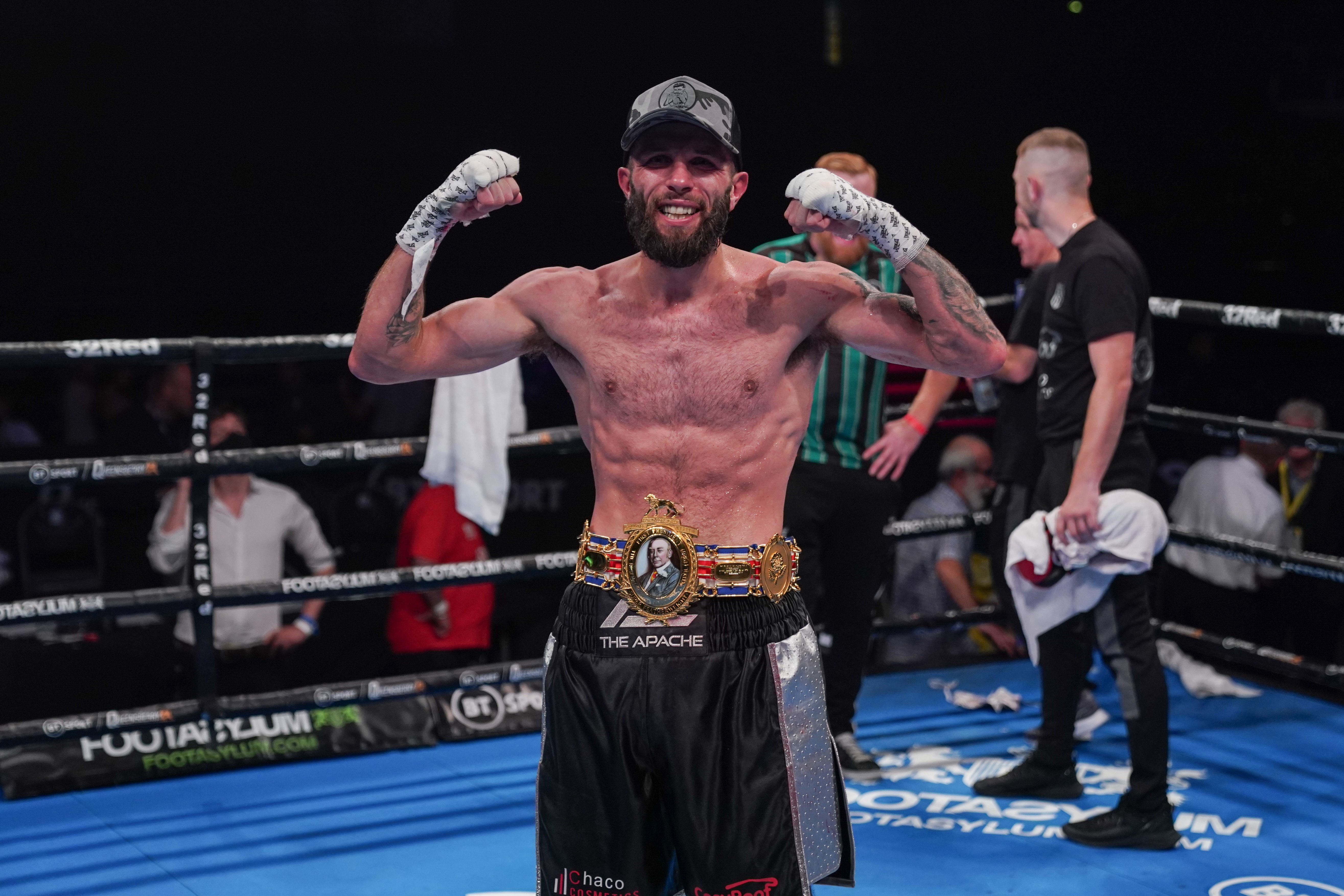 Anthony Cacace celebrates after his successful title defence against Lyon Woodstock