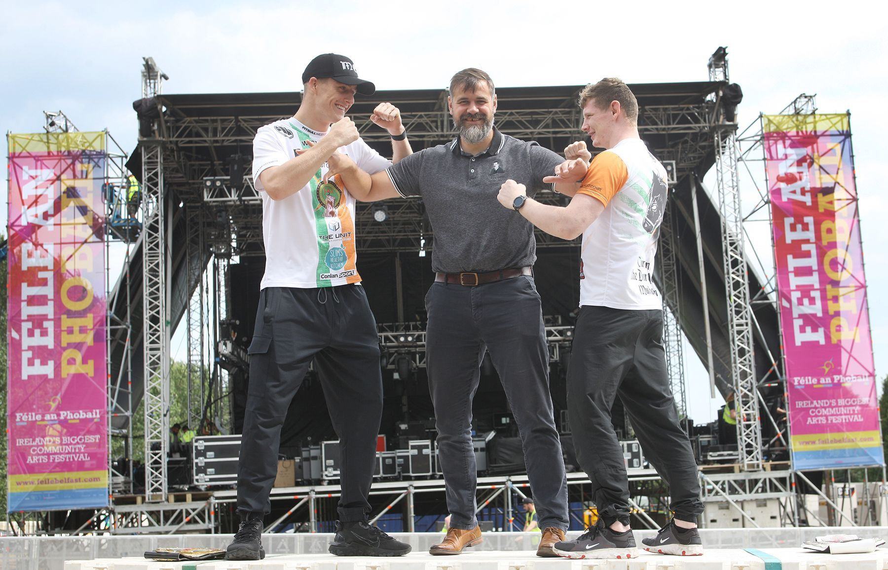 TOURISM SECTOR IS FIGHTING BACK: Harry Connolly HOLDING THEM BACK: Féile an Phobail chairperson Harry Connolly with MMA Irish title challengers Paddy McCorry and Ciaran Mulholland, ahead of Cage Conflict IV in the Falls Park during Féile 2021.