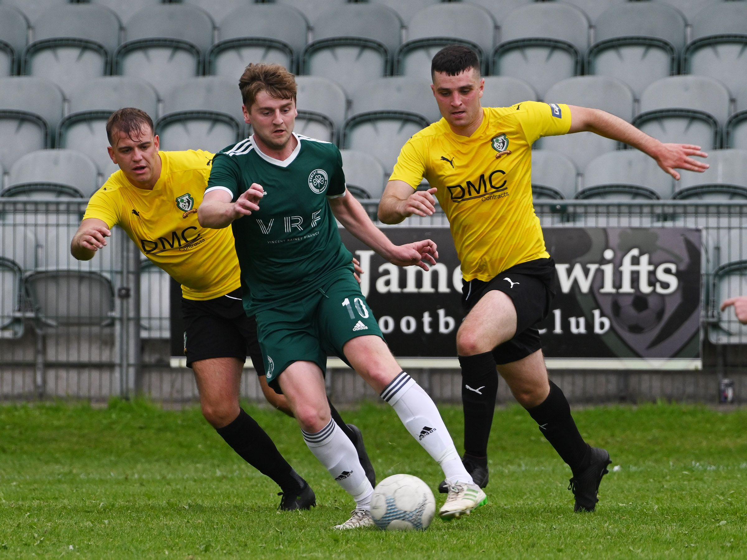 Dunloy\'s Caolan Gillan gets out in front of a couple of St James\' Swifts challenges on Saturday