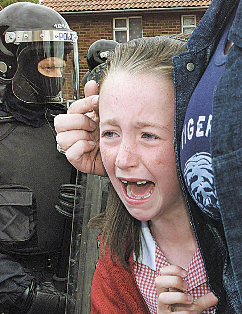 TRAUMATIC: Eirinn Flood on her way to school during the Holy Cross dispute in 2001.