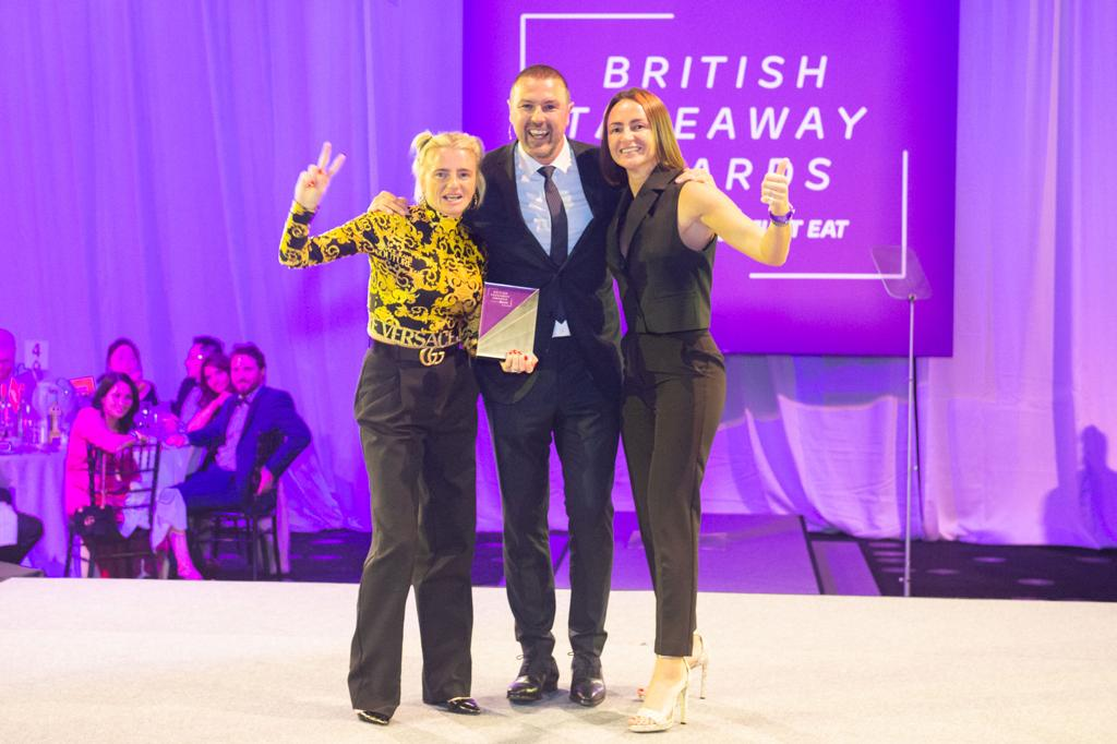 CELEBRATION: Laura and Jane Adams with comedian and TV presenter Paddy McGuinness after winning their award in London