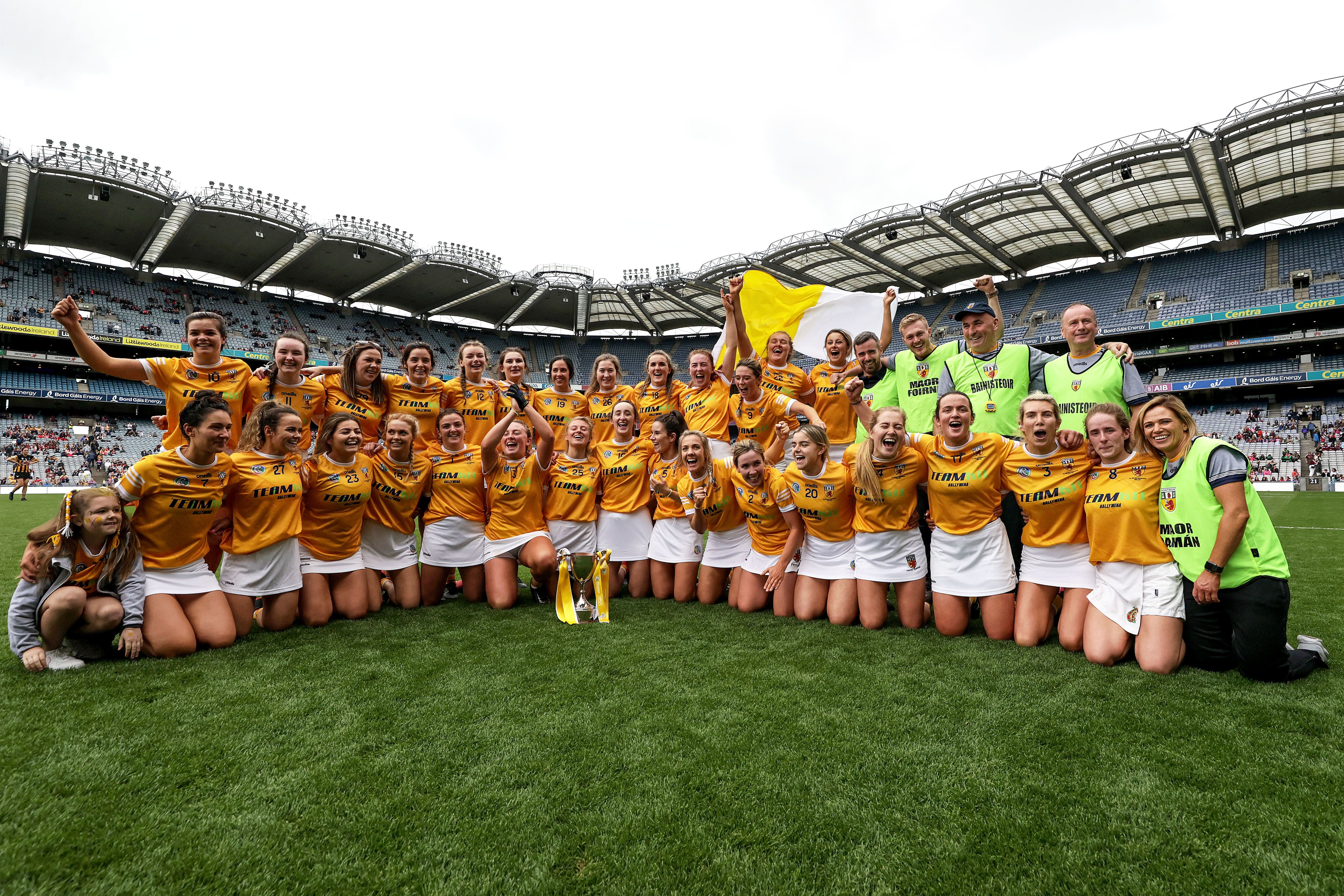 The Antrim team and management celebrate after the game