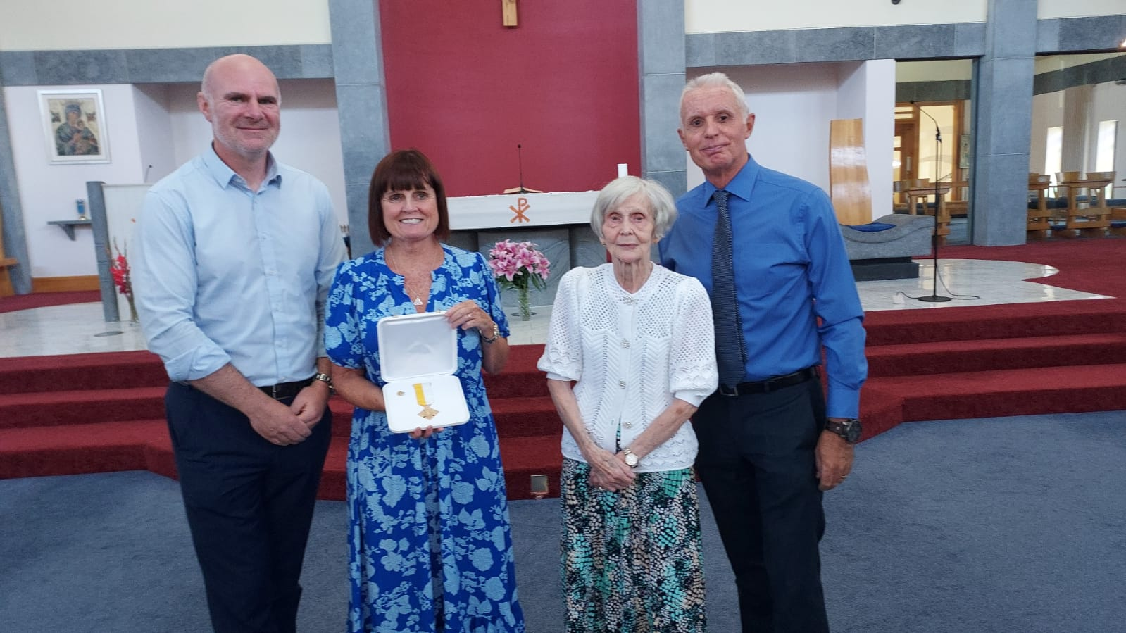 CONGRATULATIONS: Holy Trinity Primary School Principal, Fiona Enright Boyd, is joined by Father Brendan Mulhall, left, her mum, Phyllis Enright, and her husband, Joe Boyd, as she received the Benemerenti Medal