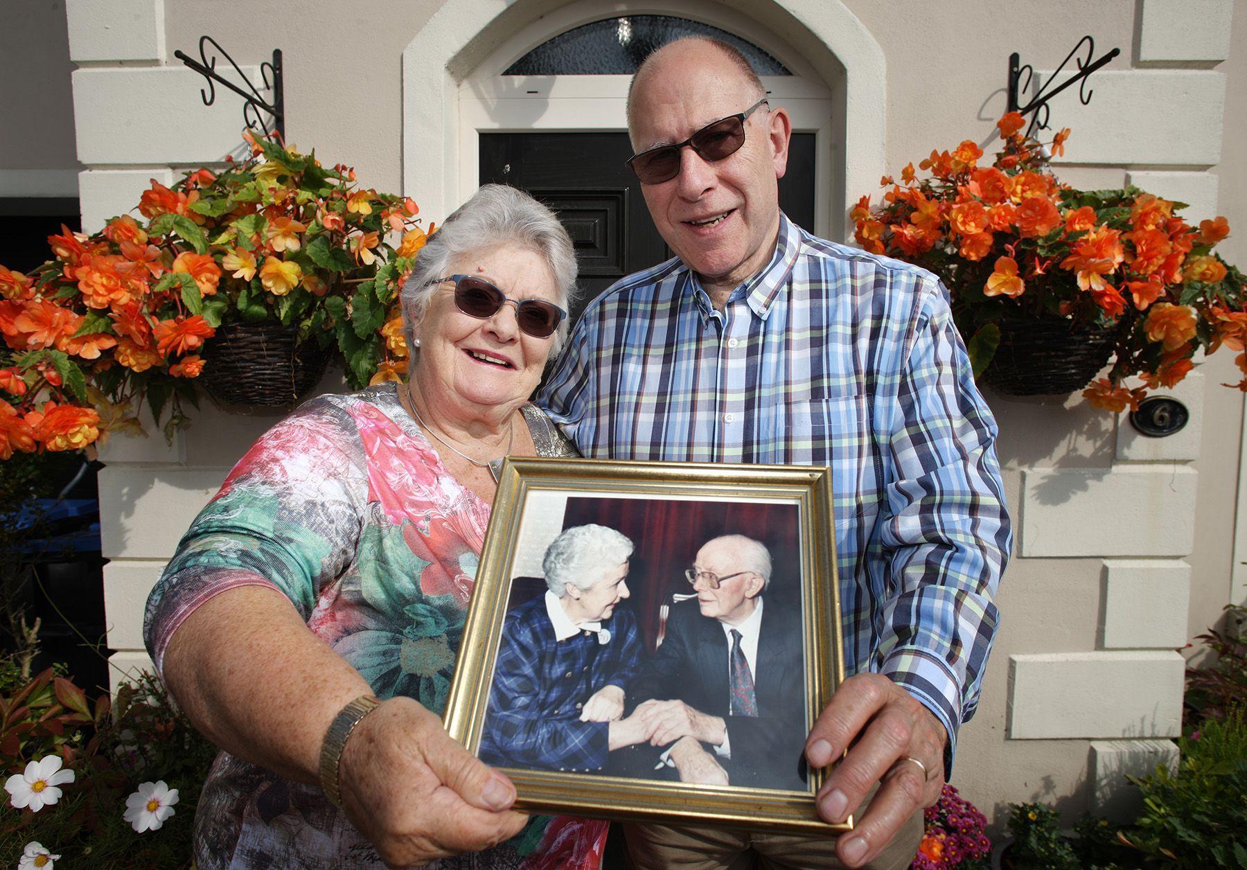 MEMORIES: Helen McKelvey and her husband, Reverend Derek McKelvey, with a treasured family portrait of Reverend Wilbur Gillespie and his wife Edna