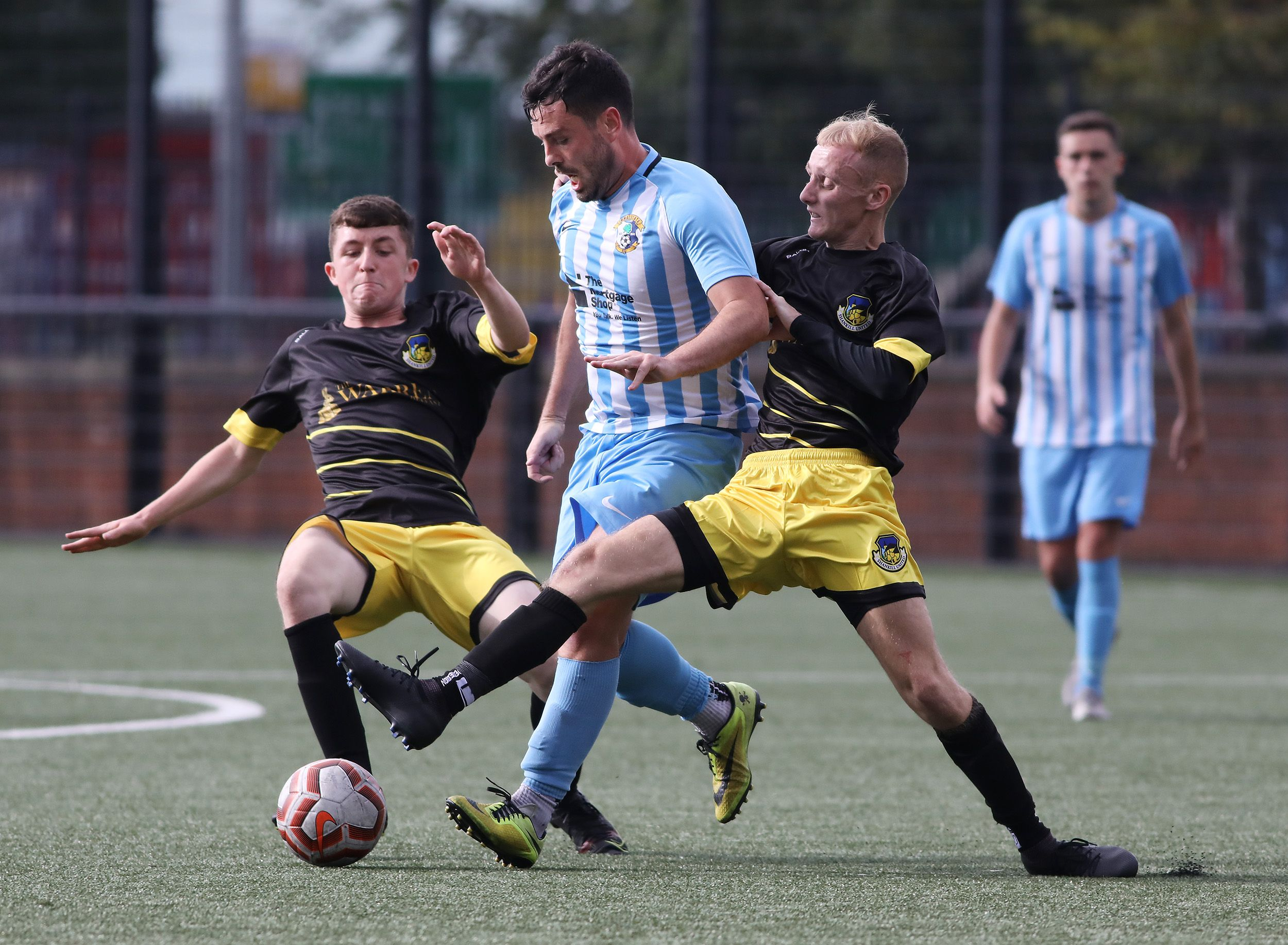 Action from Saturday\'s game between Immaculata and Shankill United