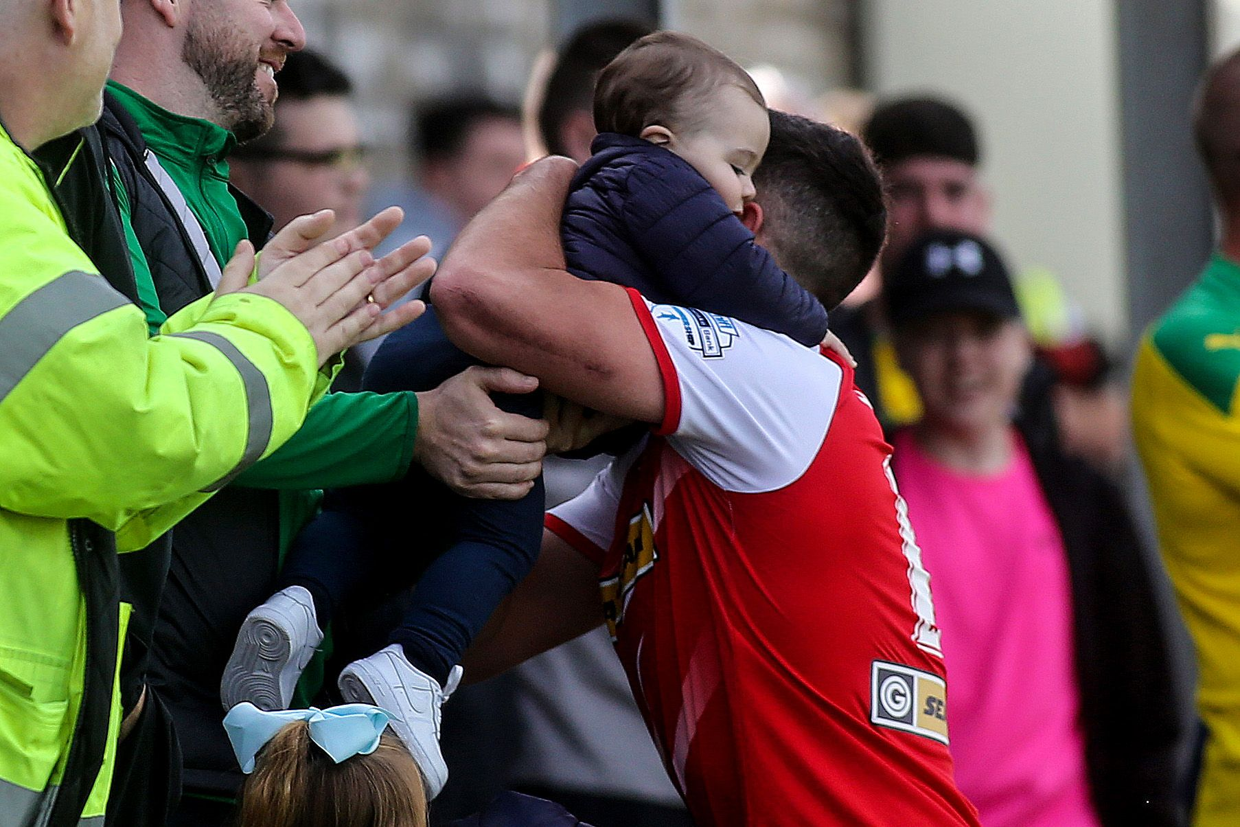 Joe Gormley celebrates with his daughter after scoring