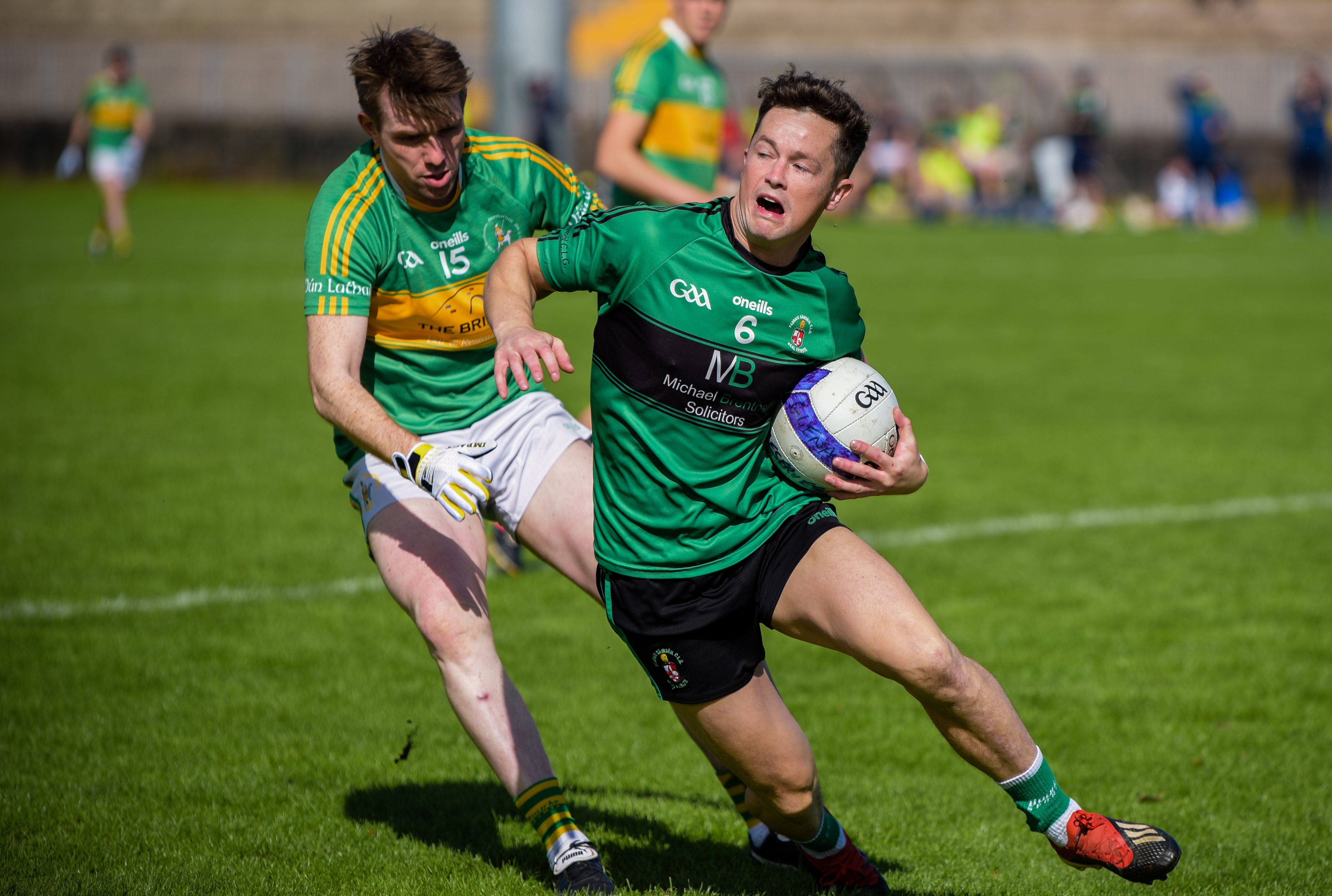 Sarsfield\'s centre-back Daniel McKernan tried to get away from Dunloy\'s Shane Dooey during Sunday\'s IFC clash at the Bear Pit