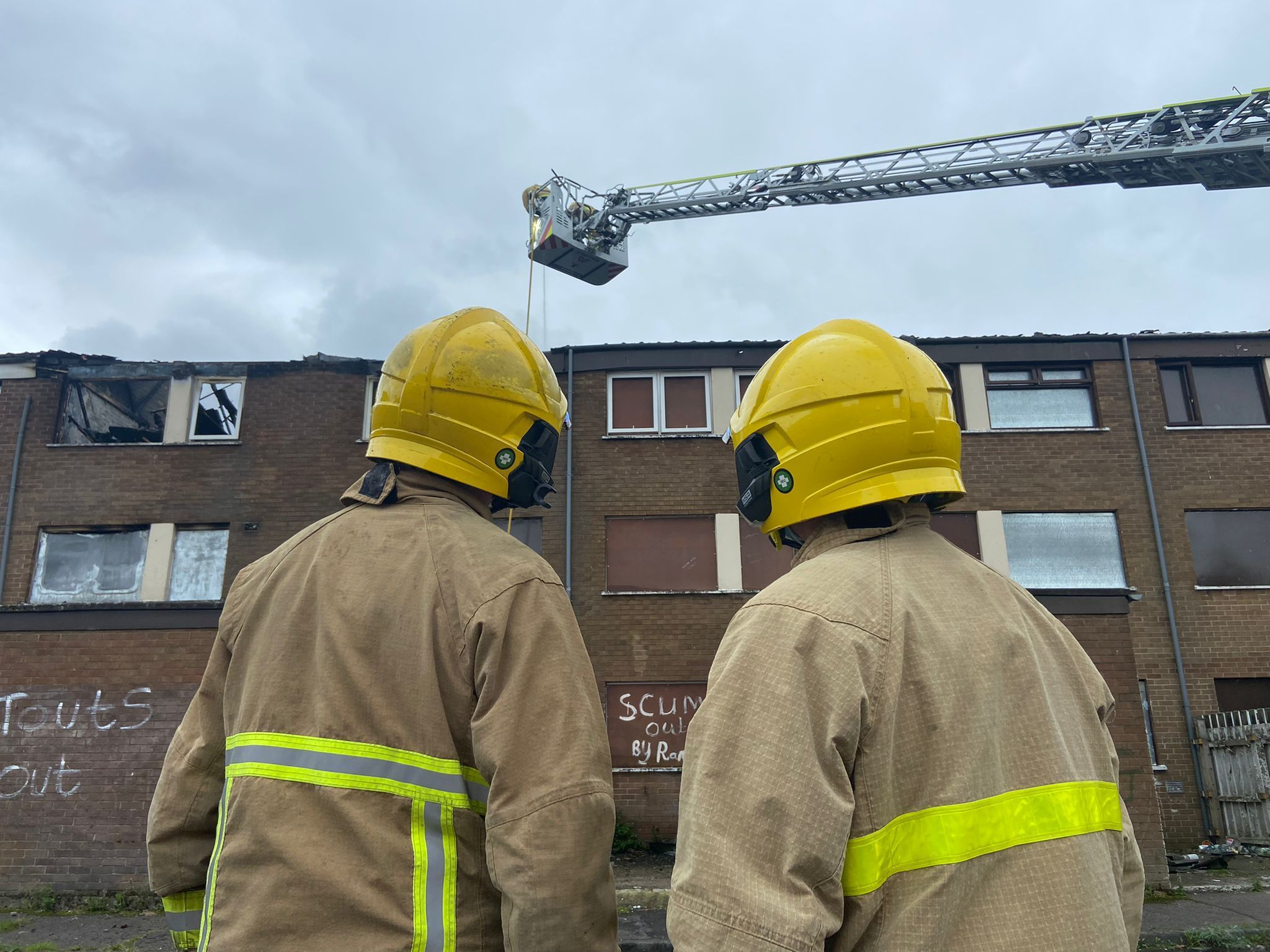 Firefighters at the scene of the fire at Ross Street flats