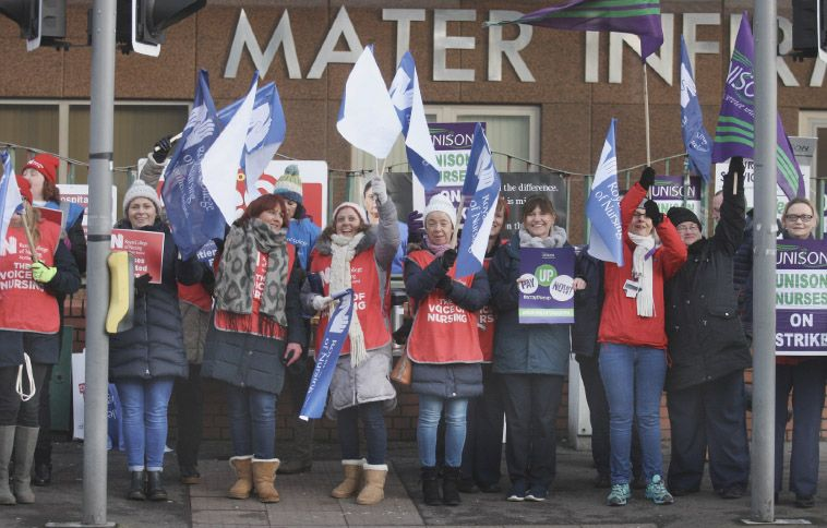 UNDERVALUED: Striking nurses is an all too common sight –and migrants face particular problems