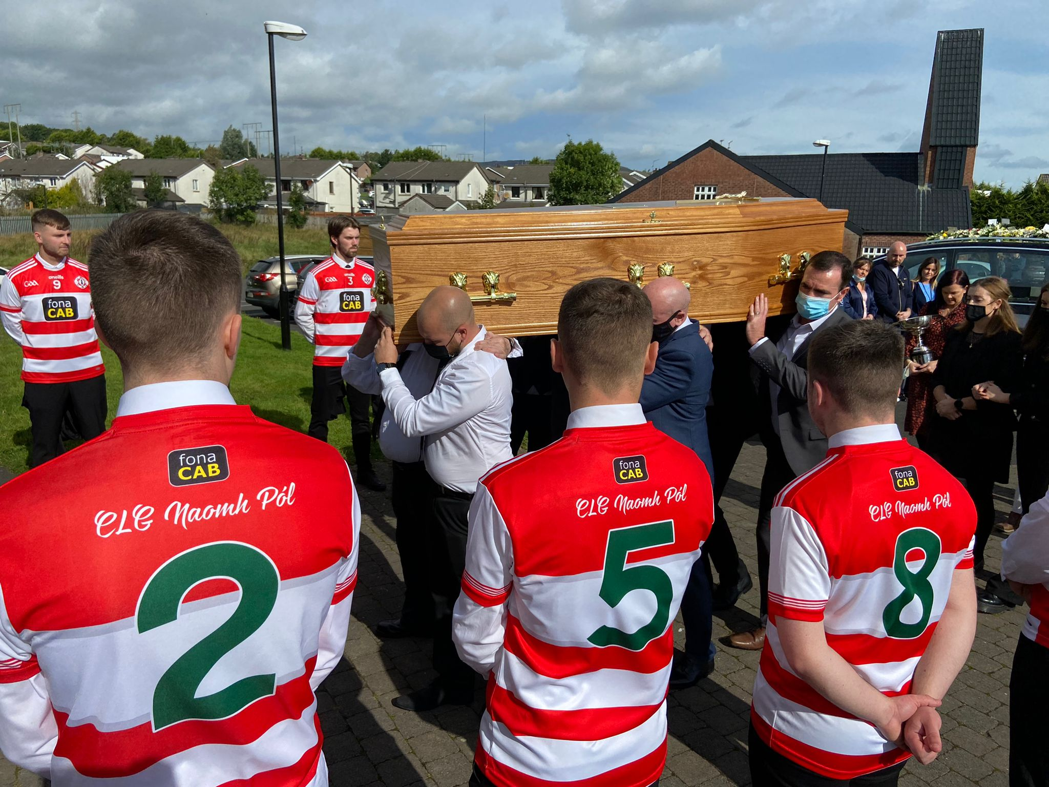 RESPECTS:St Paul's players provided a guard of honour as Anto Finnegan's coffin arrived at the church