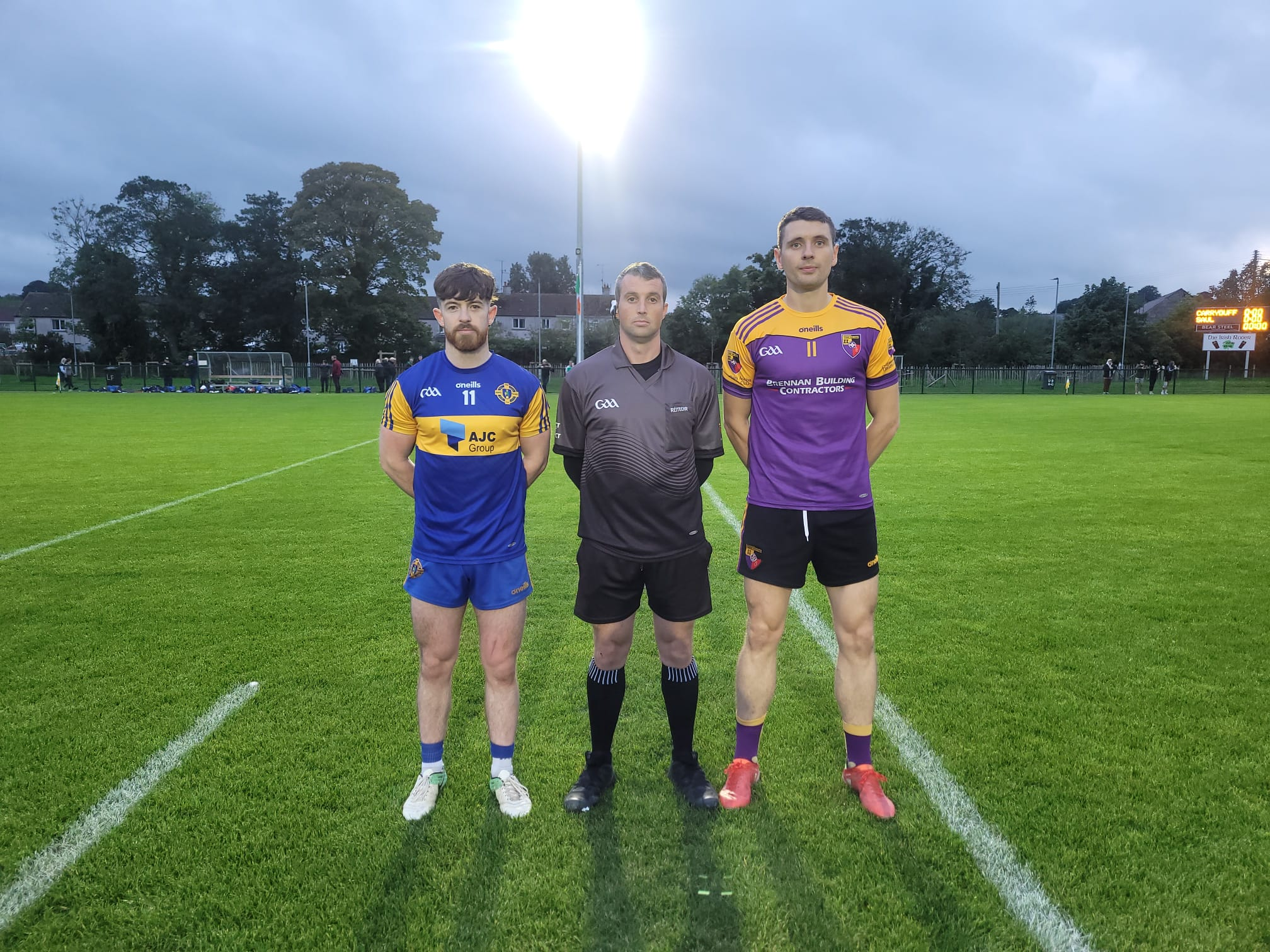 Referee Peter Owens along with Saul captain Ciarán Harney and Carryduff skipper Joe McFlynn prior to Friday night\'s Down SFC clash at Liatroim